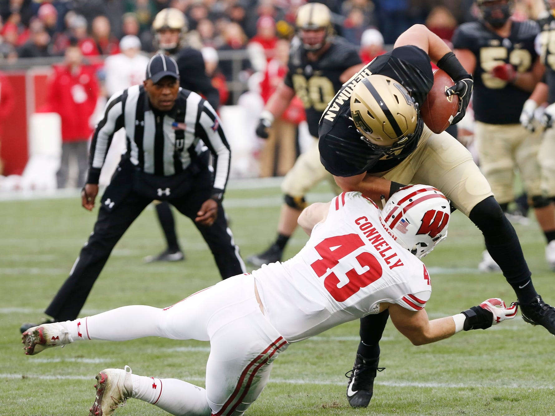 Cole Herdman of Purdue is brought down by Ryan Connelly of Wisconsin after a first half pass reception Saturday, November 17, 2018, at Ross-Ade Stadium.
