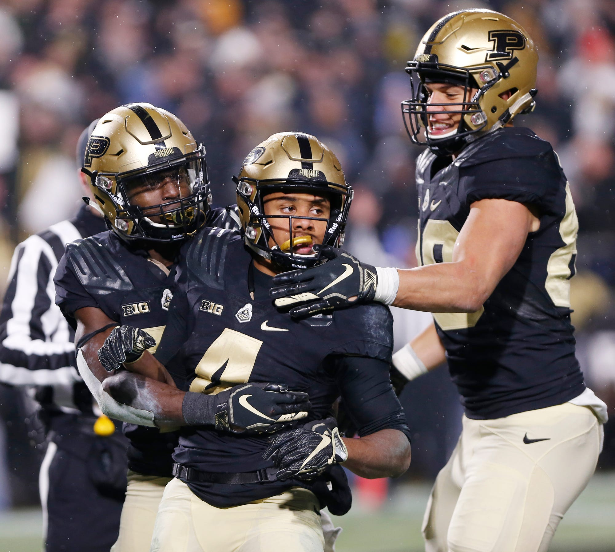 Rondale Moore, center, of Purdue celebrates with teammates after his touchdown in the first overtime period against Wisconsin Saturday, November 17, 2018, at Ross-Ade Stadium. Purdue fell to Wisconsin 47-44 3OT.