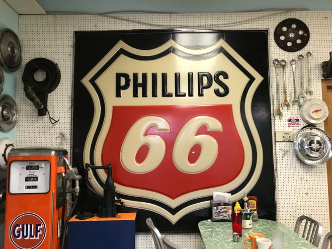 Customers bought Route 66 decorations right off the wall on Sunday. The vintage gas pump sold for $3,000.