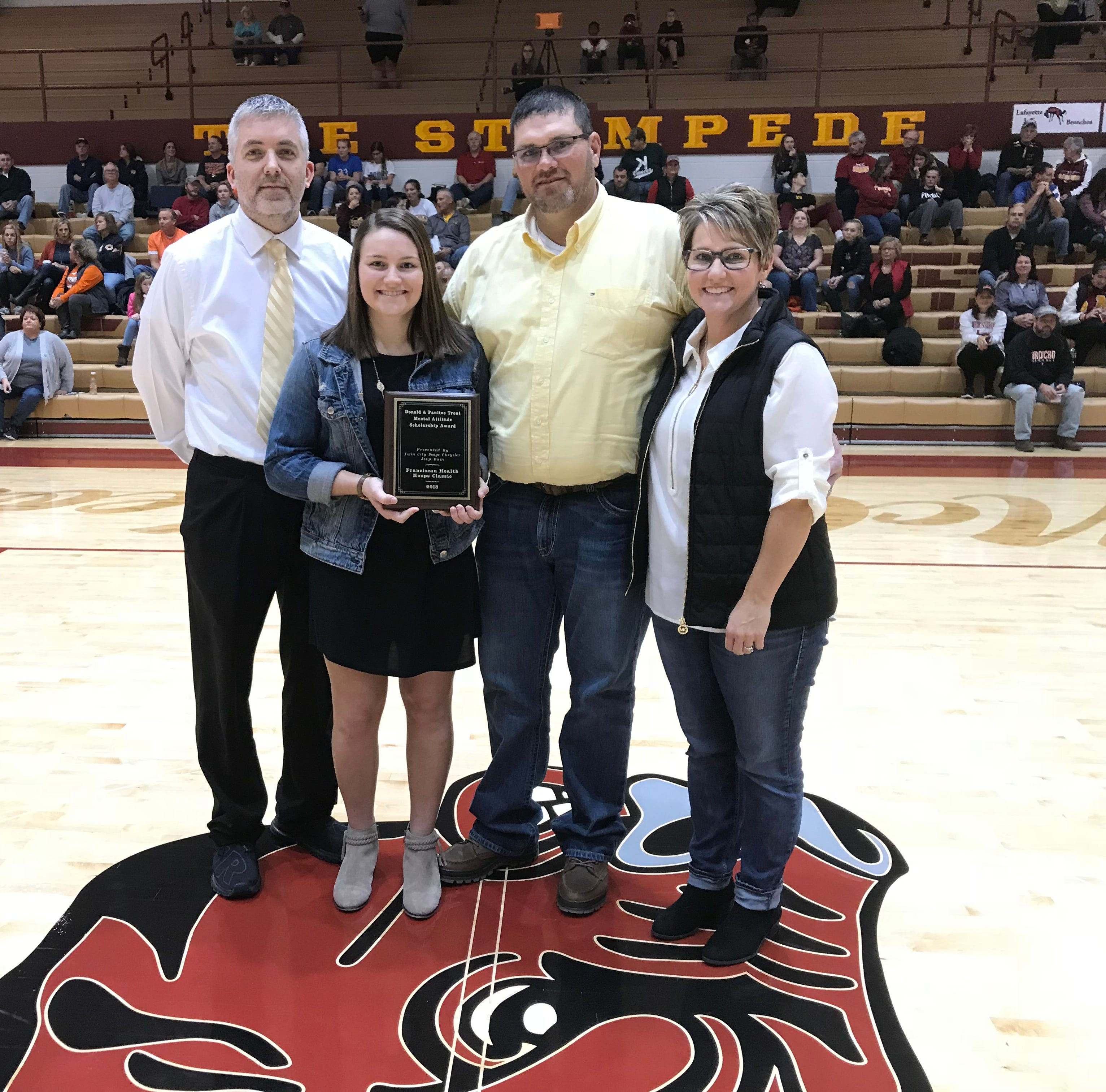 Cassidy Minniear, second from left, of Benton Central receives the Donald and Pauline Trout Memorial Scholarship.