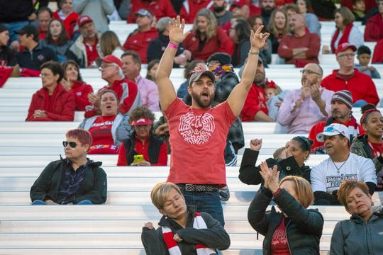 A UL fan cheering in the stands as the Ragin' Cajuns play against the South Alabama Jaguars at Cajun Field on November 17, 2018.