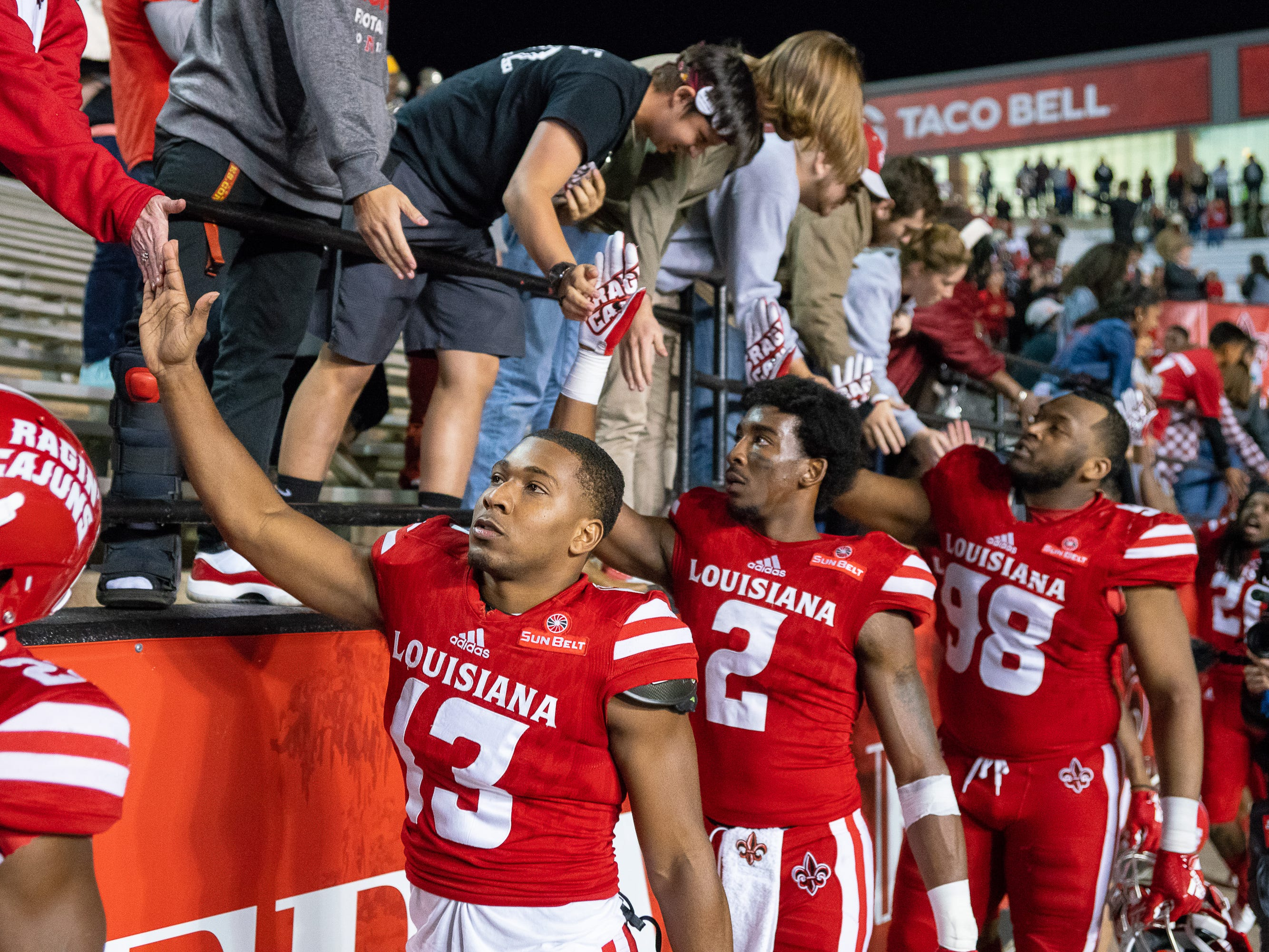 Players celebrate with UL fans after the game as the Ragin' Cajuns play against the South Alabama Jaguars at Cajun Field on November 17, 2018.