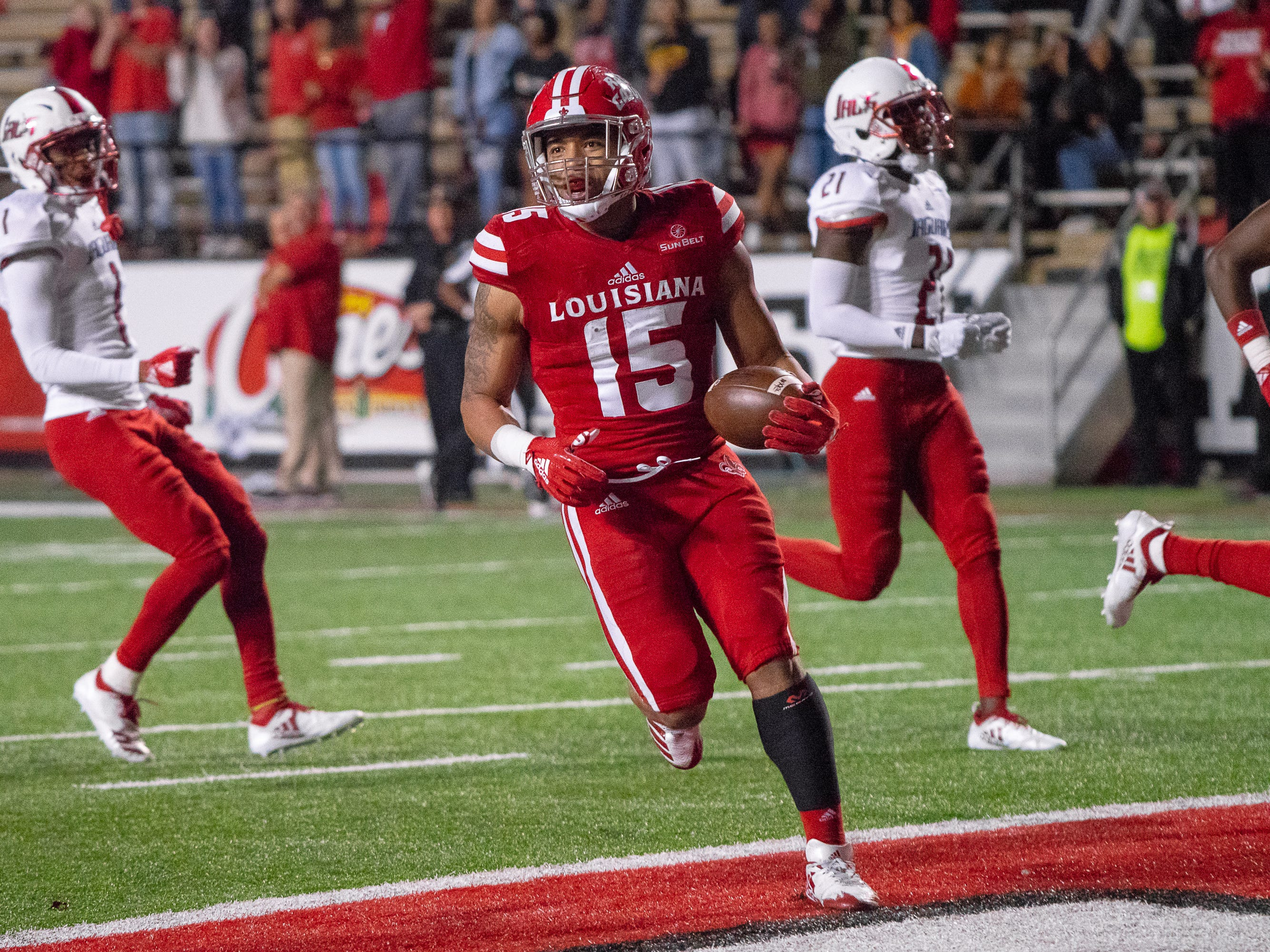 UL's Elijah Mitchell runs into the endzone to score a touchdown for his team as the Ragin' Cajuns play against the South Alabama Jaguars at Cajun Field on November 17, 2018.