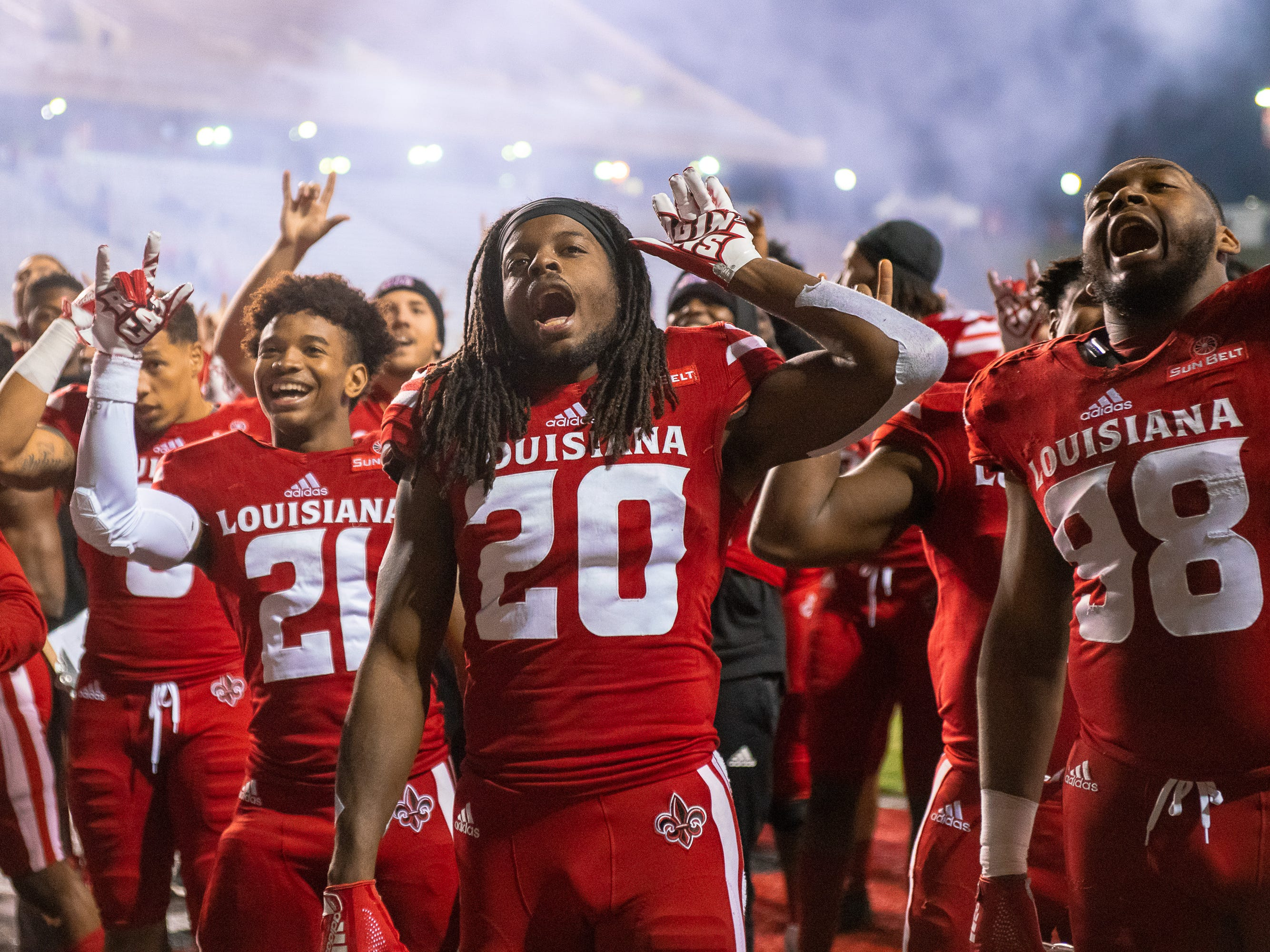 UL's Jarrod Jackson celebrates with his team after the game as the Ragin' Cajuns play against the South Alabama Jaguars at Cajun Field on November 17, 2018.