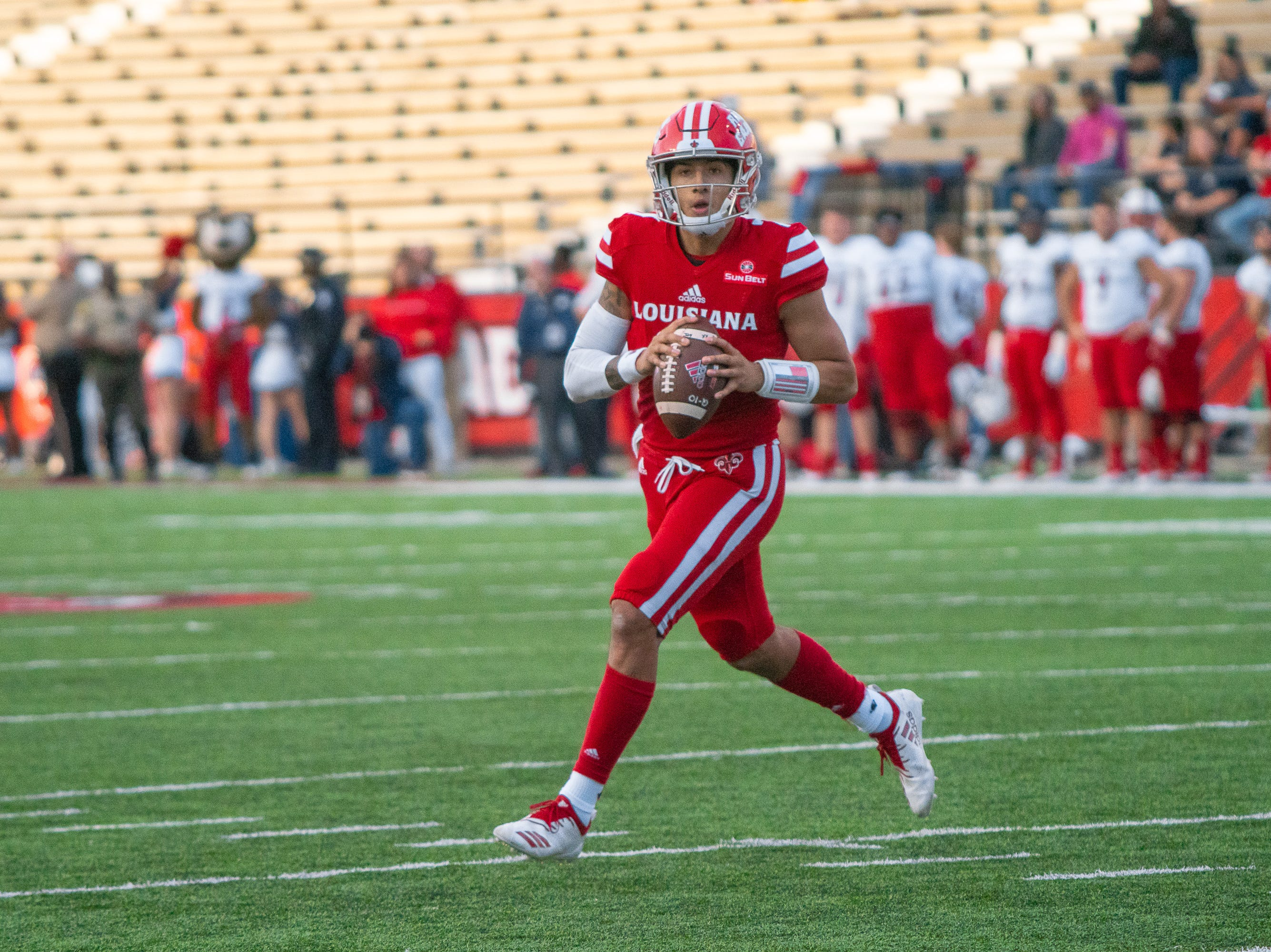 UL's senior quarterback Andre Nunez looks for an open pass during the play as the Ragin' Cajuns play against the South Alabama Jaguars at Cajun Field on November 17, 2018.