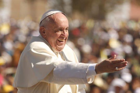 Pope Francis waves to pilgrims in San Cristobal de las Casas, Mexico, on Feb. 15, 2016.