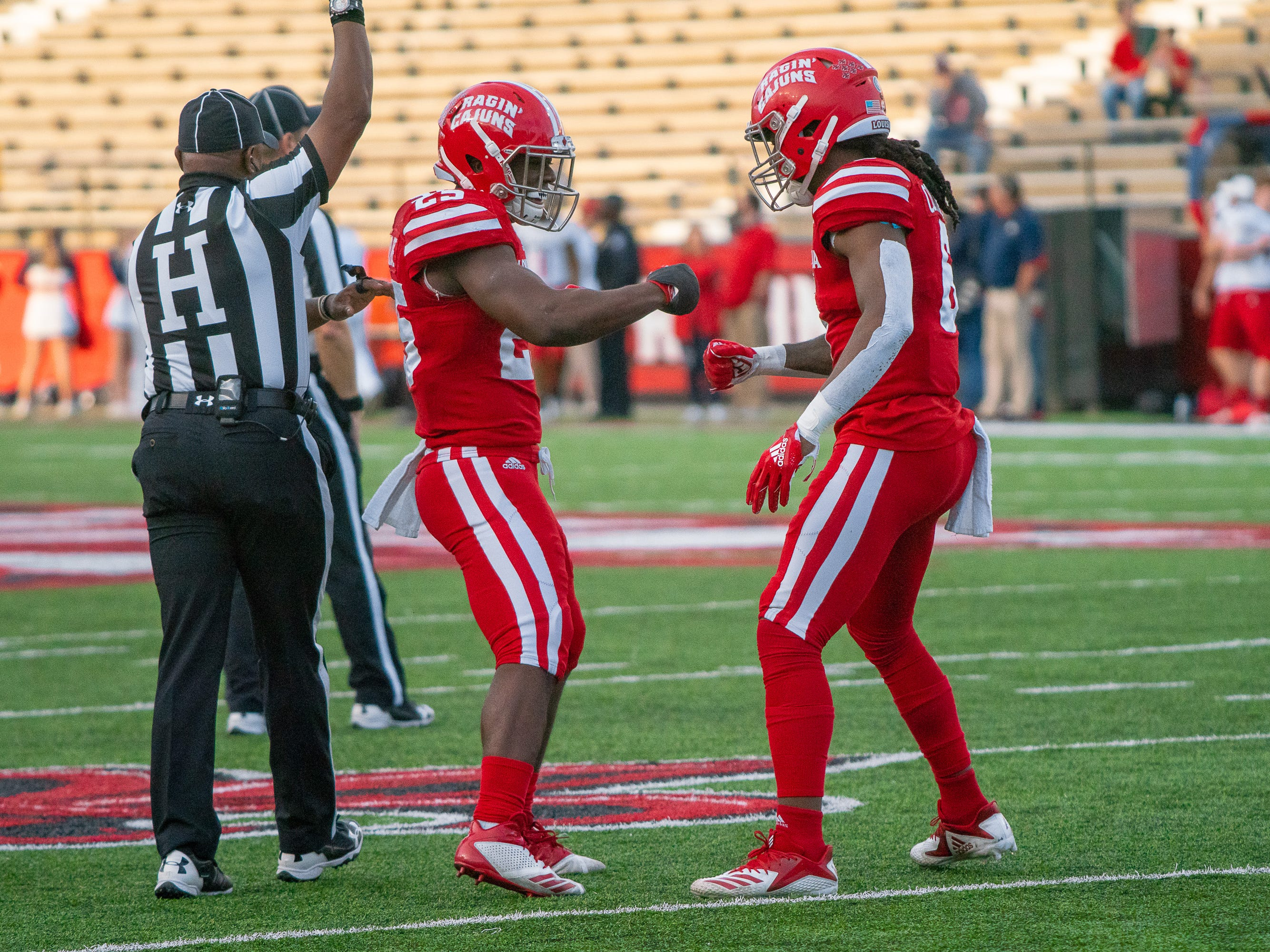 UL's Deuce Wallace celebrates his interception with teammate Corey Turner as the Ragin' Cajuns play against the South Alabama Jaguars at Cajun Field on November 17, 2018.