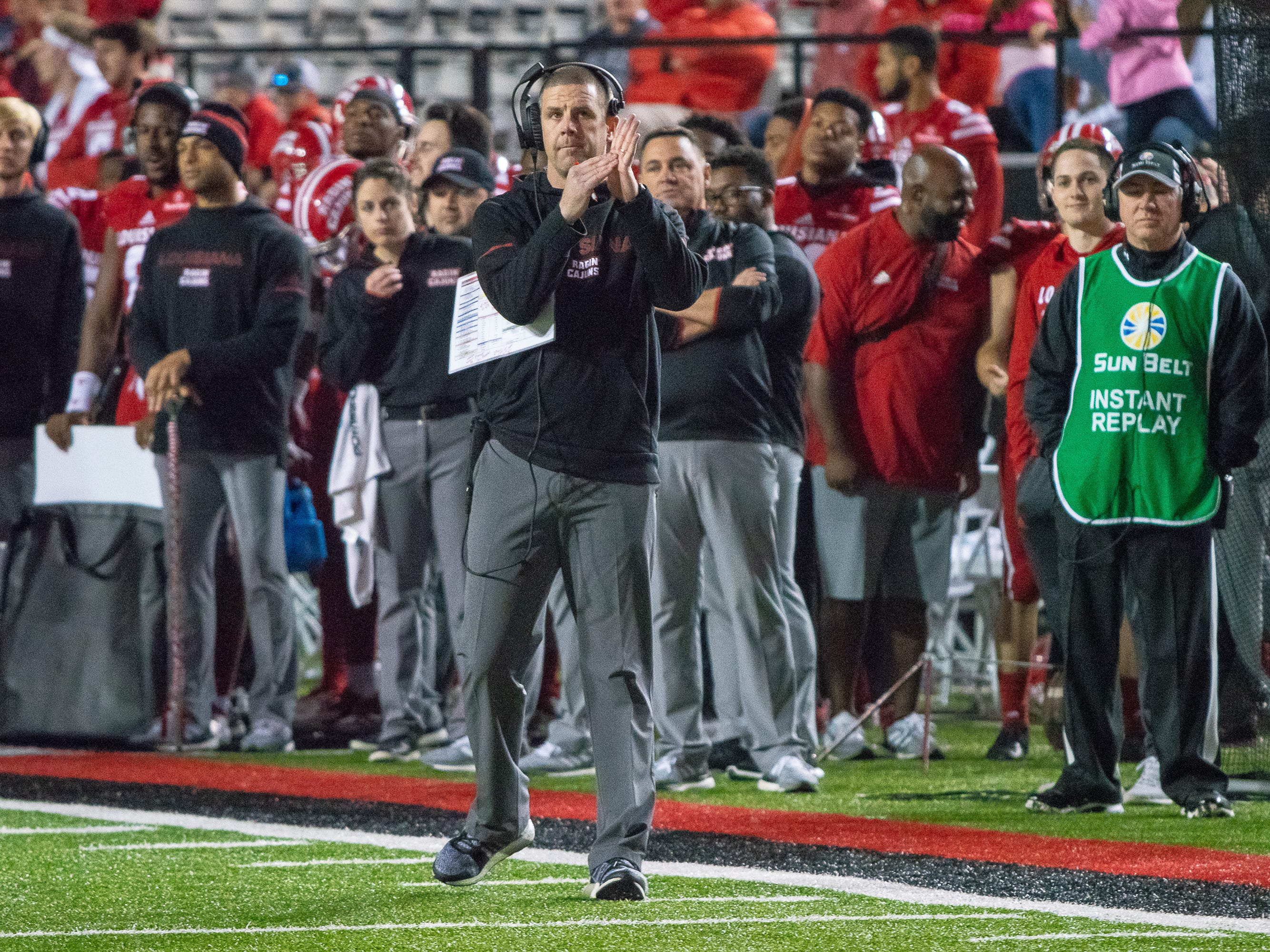 UL's head football coach Billy Napier calls for a timeout in the fourth quarter as the Ragin' Cajuns play against the South Alabama Jaguars at Cajun Field on November 17, 2018.