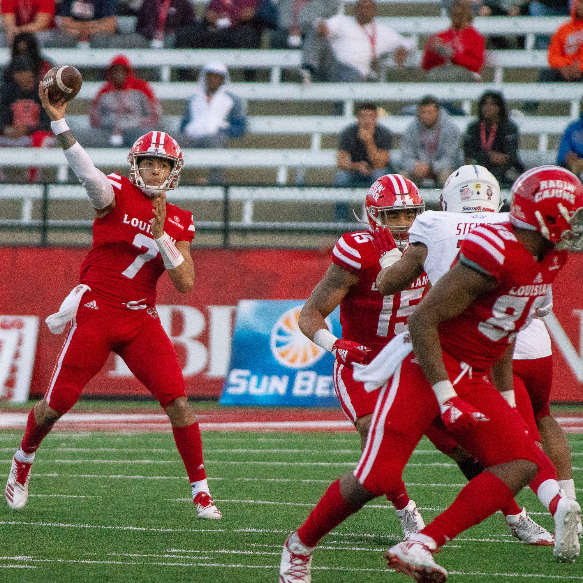 UL's senior quarterback Andre Nunez throws a pass to a receiver as the Ragin' Cajuns play against the South Alabama Jaguars at Cajun Field on November 17, 2018.