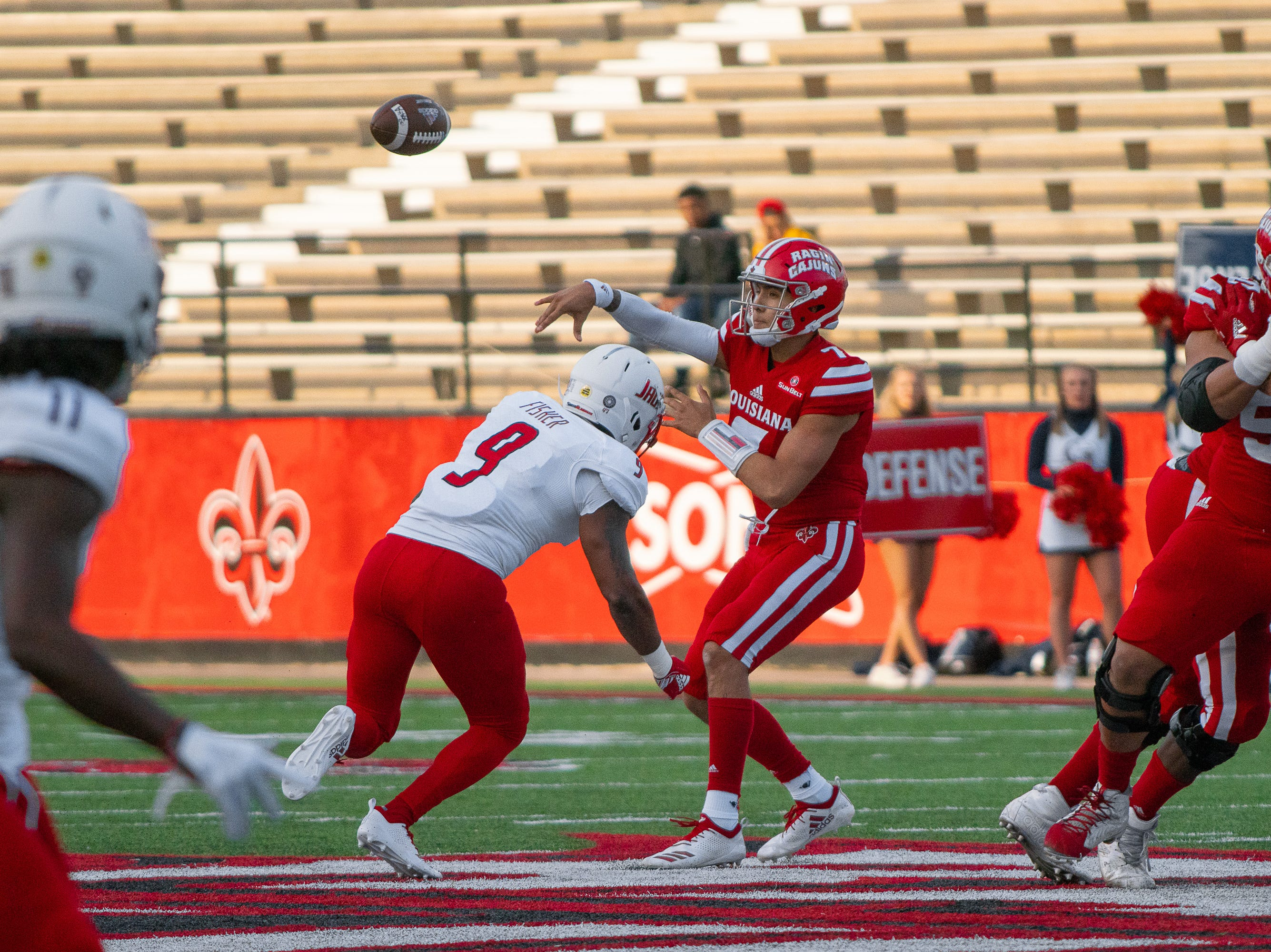 UL's senior quarterback throws a pass towards the sideline as the Ragin' Cajuns play against the South Alabama Jaguars at Cajun Field on November 17, 2018.
