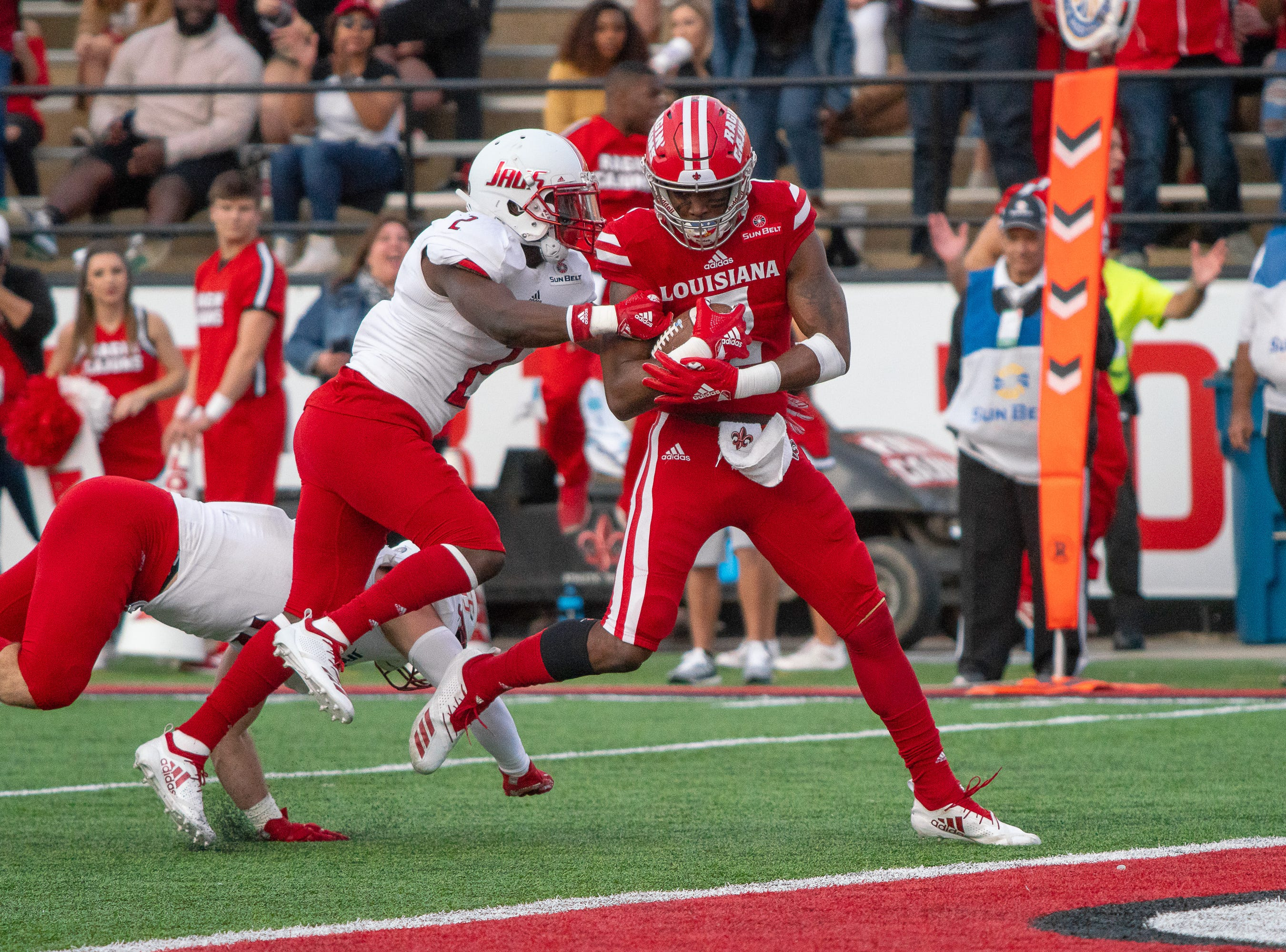 UL's Ja'Marcus Bradley runs the ball into the endzone to score a touchdown as the Ragin' Cajuns play against the South Alabama Jaguars at Cajun Field on November 17, 2018.
