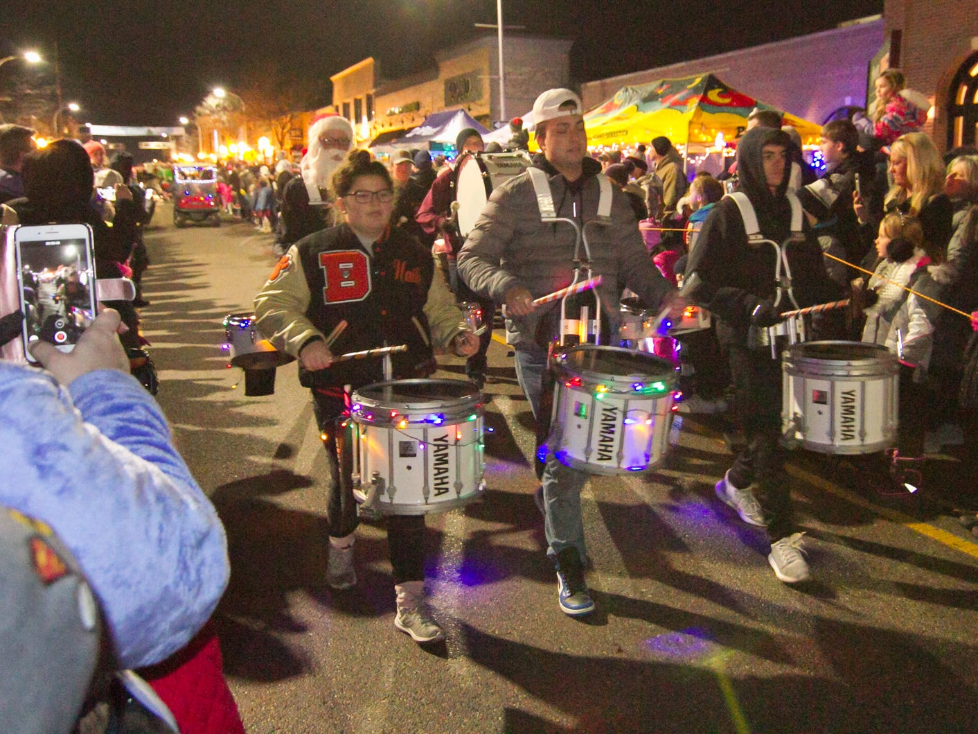 Members of Brighton's marching band lead the procession of Santa and reindeer in the Holiday Glow Saturday, Nov. 17, 2018.