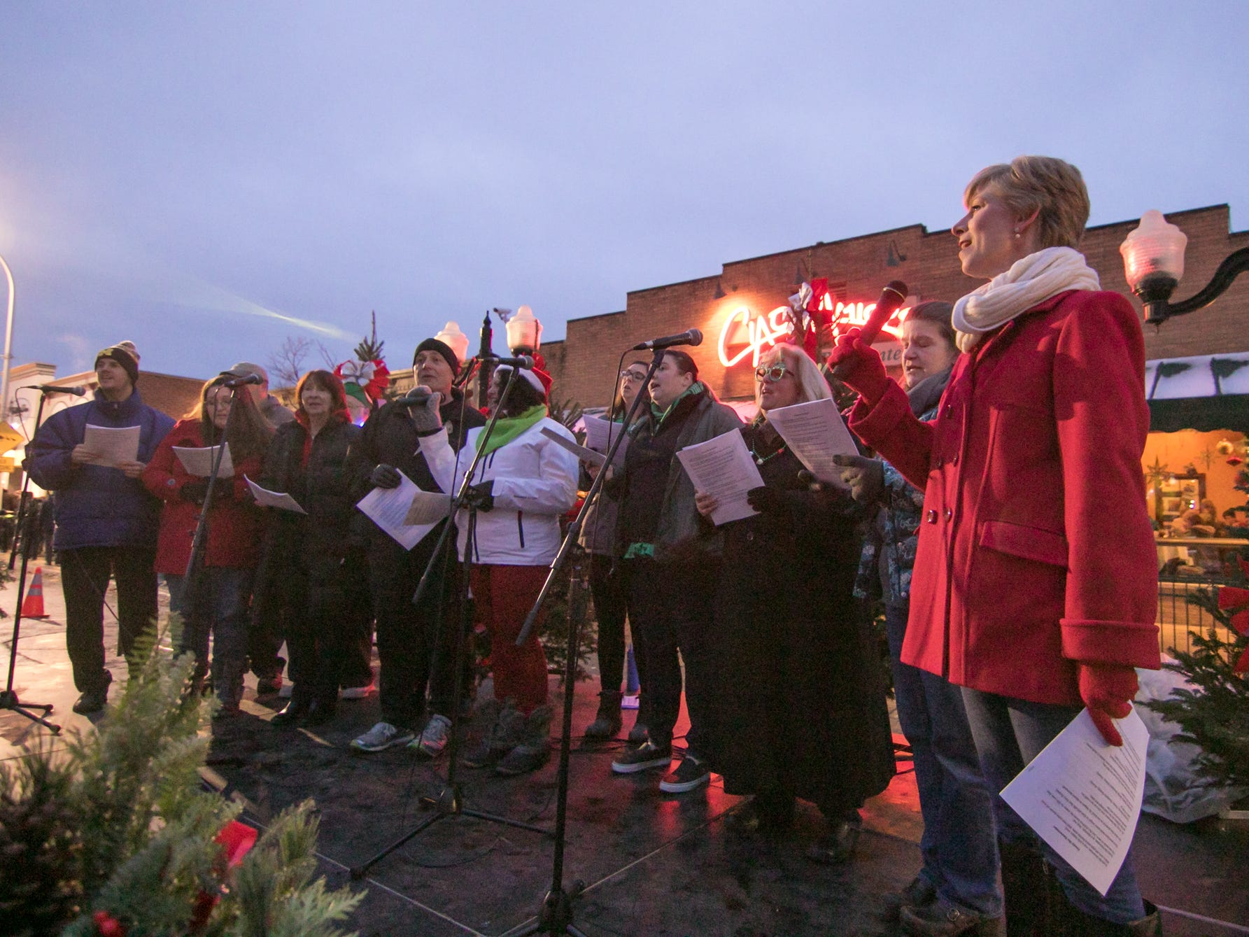 Cornerstone Church's carolers lead the crowd surrounding a stage on Main Street in Christmas carols Saturday, Nov. 17, 2018 at the Holiday Glow.