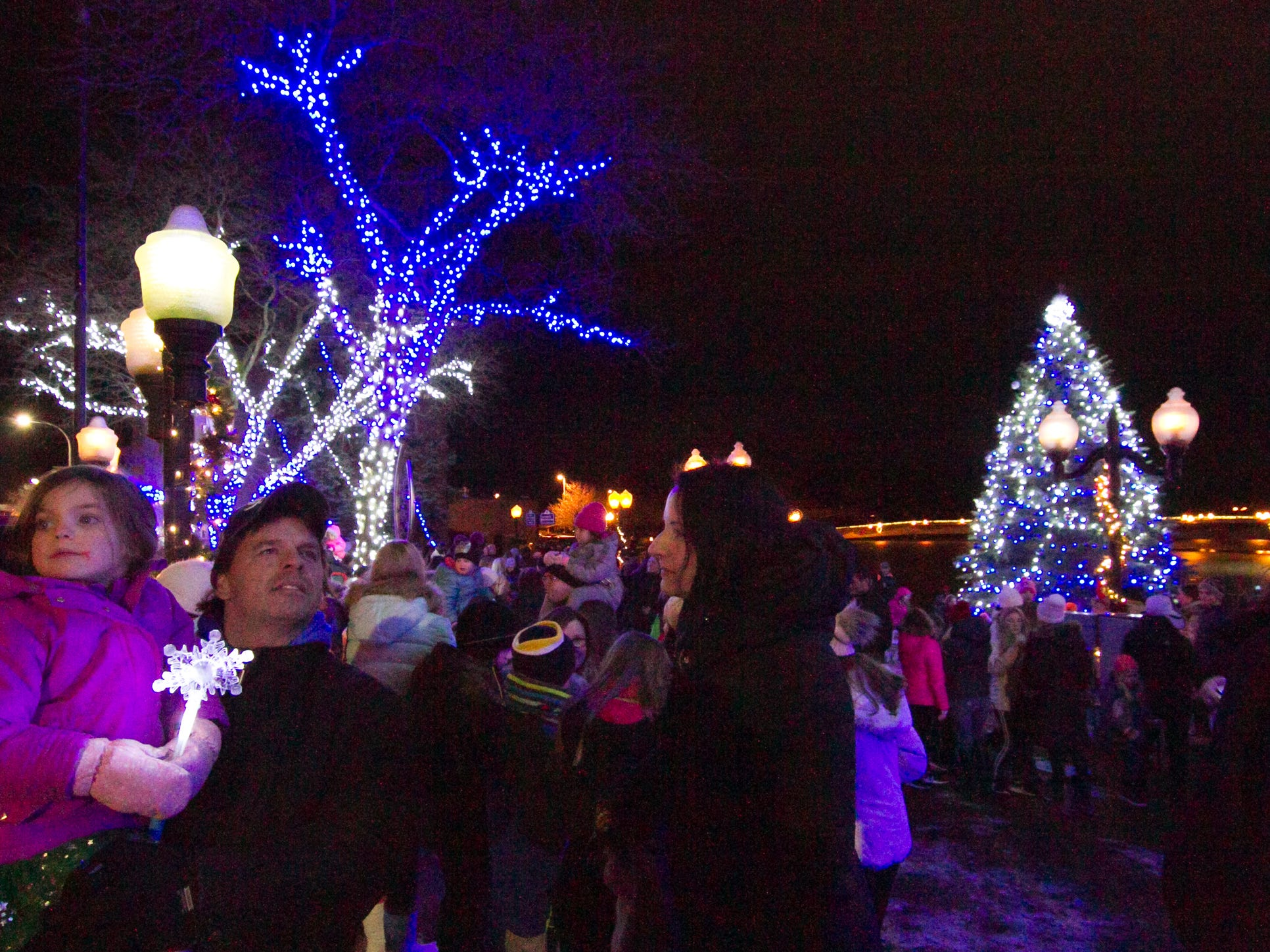 Lights on the Mill Pond and in the Christmas tree are lit on command from Santa Claus Saturday, Nov. 17, 2018 at Brighton's Holiday Glow.