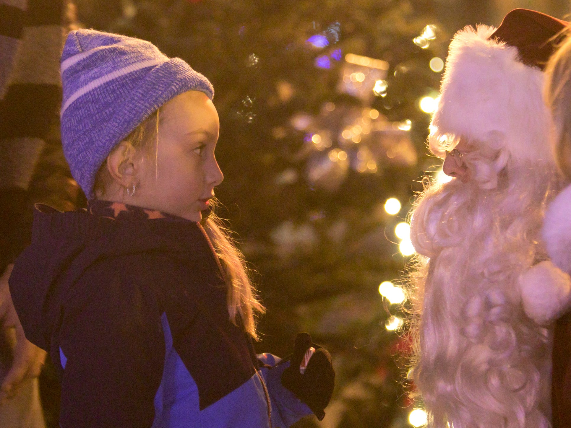 5-year-old Charlotte Cheresko tells Santa her wishes for Christmas at Brighton's Holiday Glow Saturday, Nov. 17, 2018.