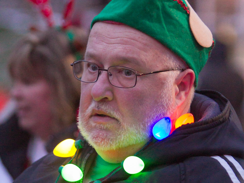 Rod Shelton of Cornerstone Church's carolers dresses for holiday spirit Saturday, Nov. 17, 2018 at Brighton's Holiday Glow.
