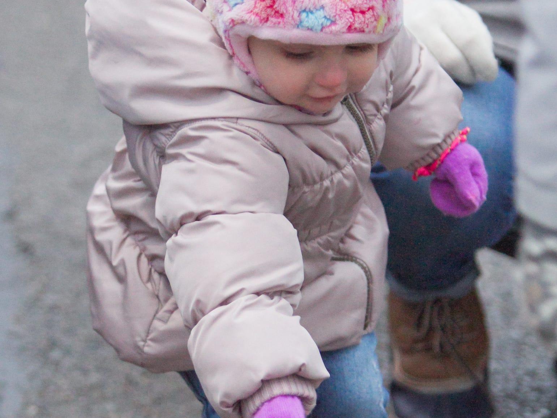 2-year-old Sloane Bau tosses rings at the Brighton Holiday Glow Saturday, Nov. 17, 2018.