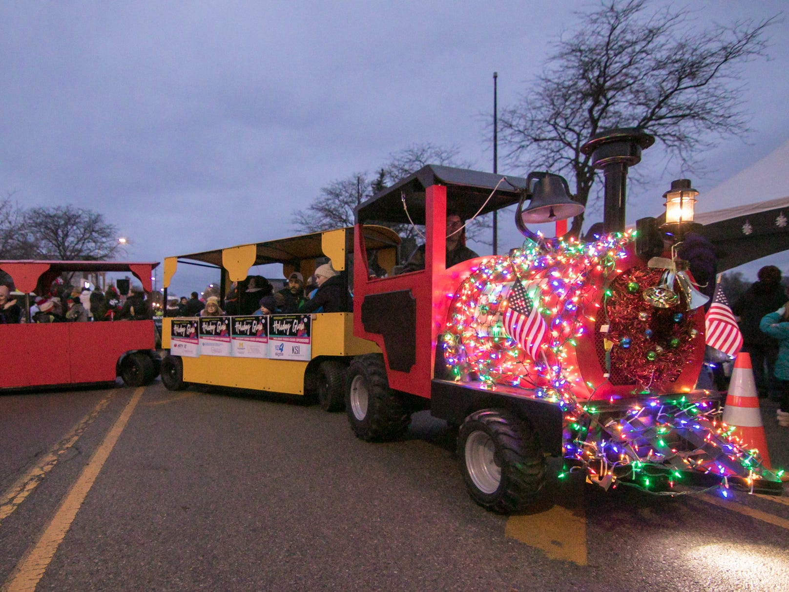 A miniature train provided by Little Conductors Trackless Trains gives rides at Brighton's Holiday Glow Saturday, Nov. 17, 2018.