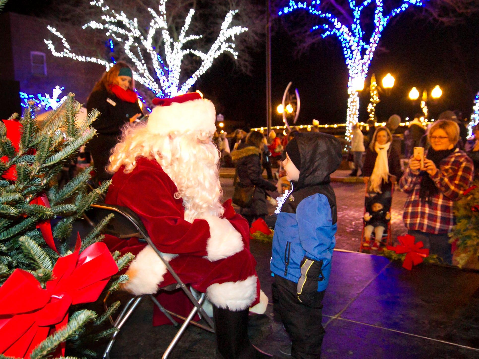 4-year-old Weston Adams of Hartland shares his Christmas list with Santa Claus Saturday, Nov. 17, 2018 at the Brighton Holiday Glow.