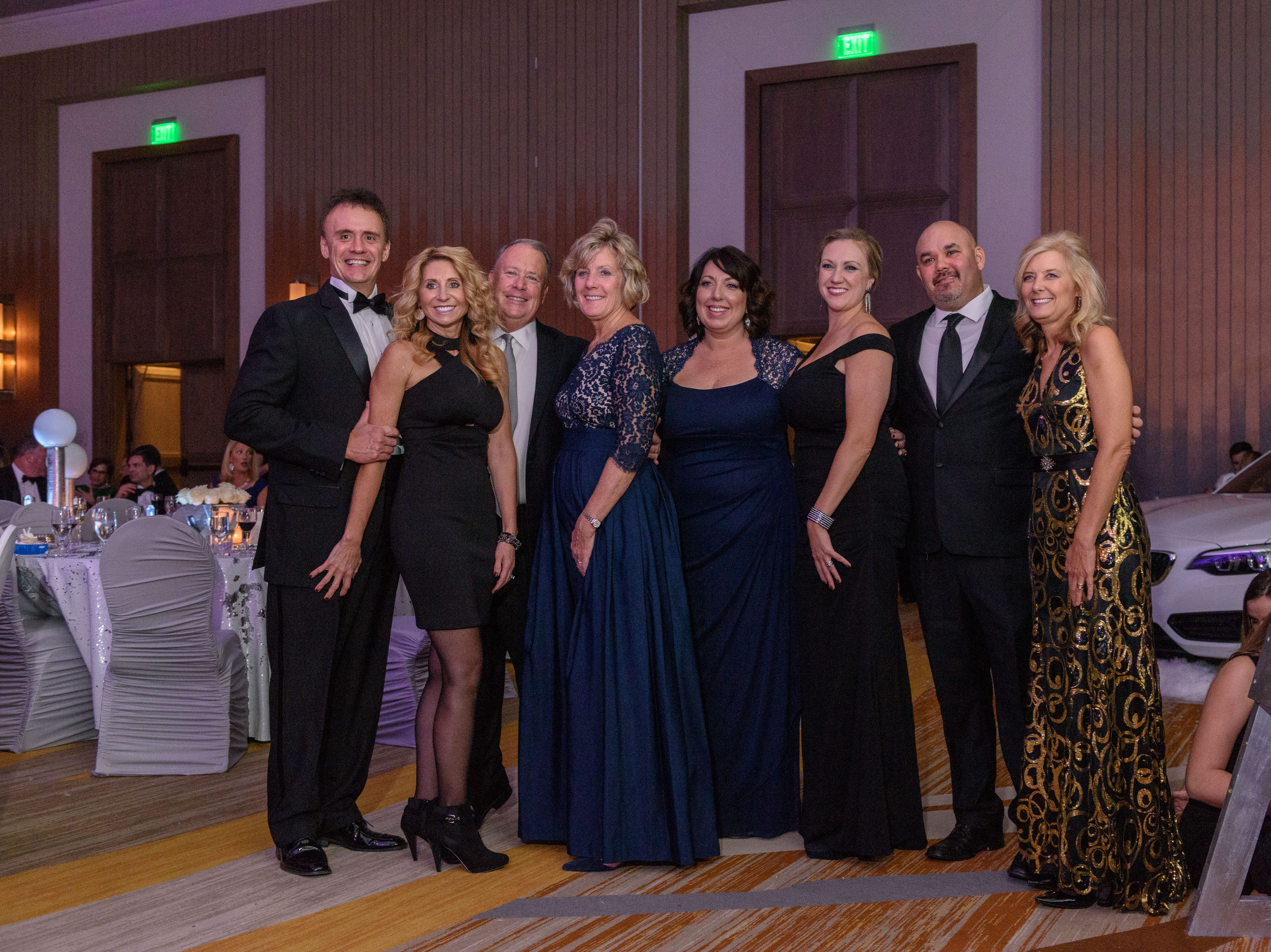 A group poses for a photo at the Snow Ball Gala at the Omni Hotel, a benefit for the Jennifer Lawrence Cardiac Intensive Care Unit (CICU) at Norton ChildrenÕs Hospital. Nov. 17, 2018