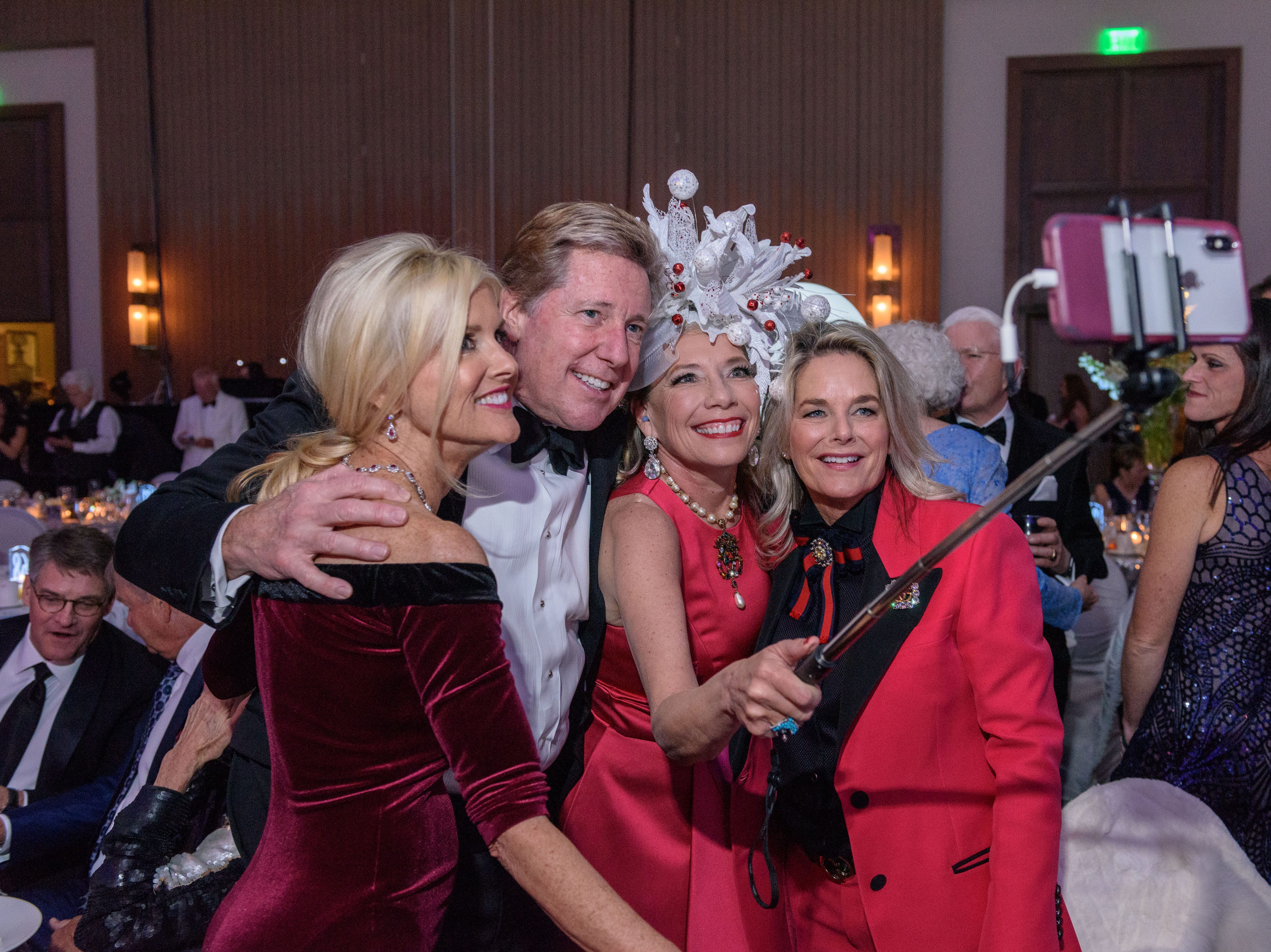 Angela and Marty Arnett, Joyce Meyer and Lisa Stemler use a selfie stick to take a picture at the Snow Ball Gala at the Omni Hotel, a benefit for the Jennifer Lawrence Cardiac Intensive Care Unit (CICU) at Norton ChildrenÕs Hospital. Nov. 17, 2018