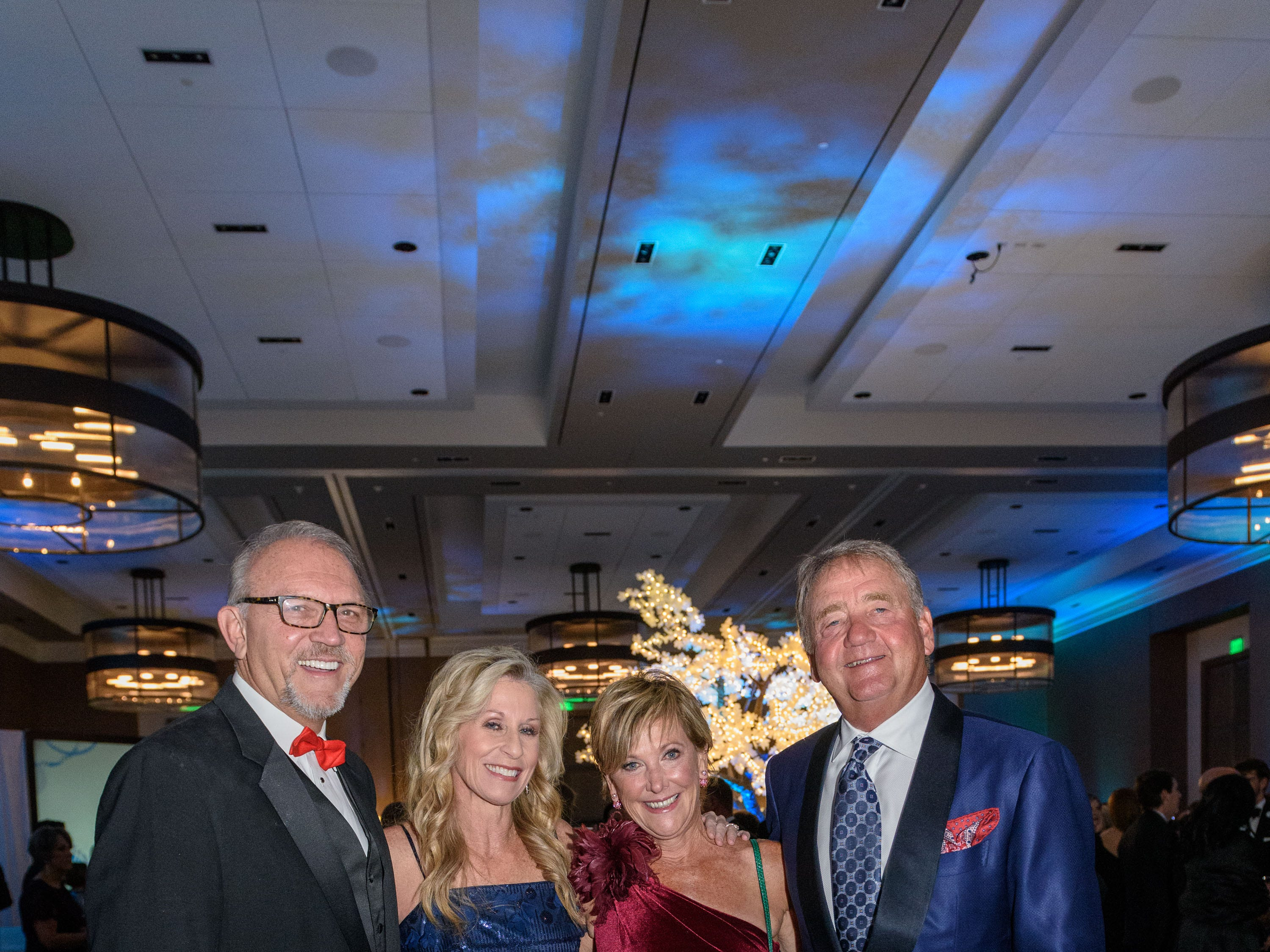 Russ and Kathy Cox pose for a photo with Karen and Gary Lawrence at the Snow Ball Gala at the Omni Hotel, a benefit for the Jennifer Lawrence Cardiac Intensive Care Unit (CICU) at Norton ChildrenÕs Hospital. Nov. 17, 2018