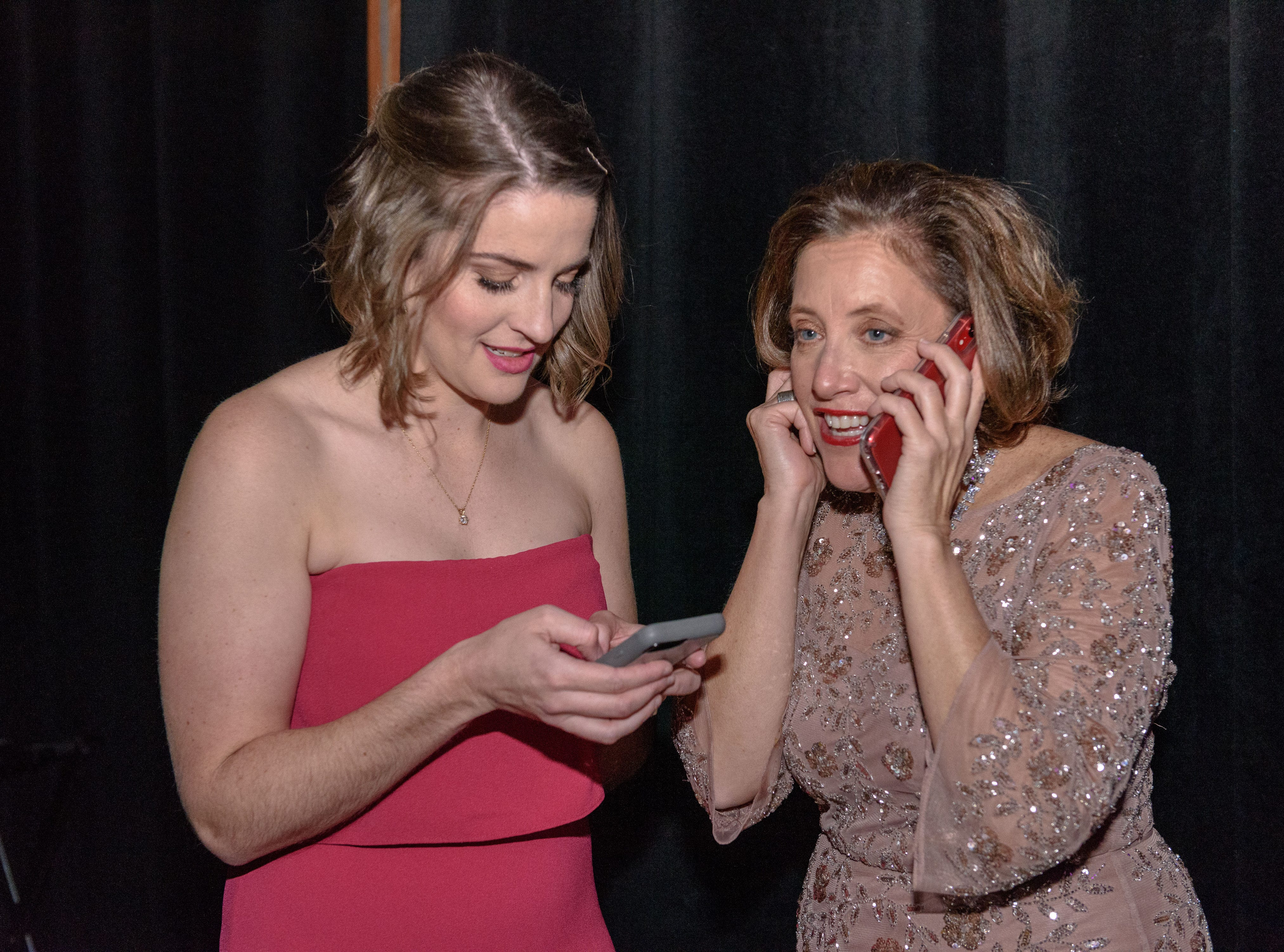 Julia Leggett and Lynnie Meyer, Ed.D, Chief Development Officer, Norton Healthcare go backstage to call a raffle winner at the Snow Ball Gala at the Omni Hotel, a benefit for the Jennifer Lawrence Cardiac Intensive Care Unit (CICU) at Norton ChildrenÕs Hospital. Nov. 17, 2018