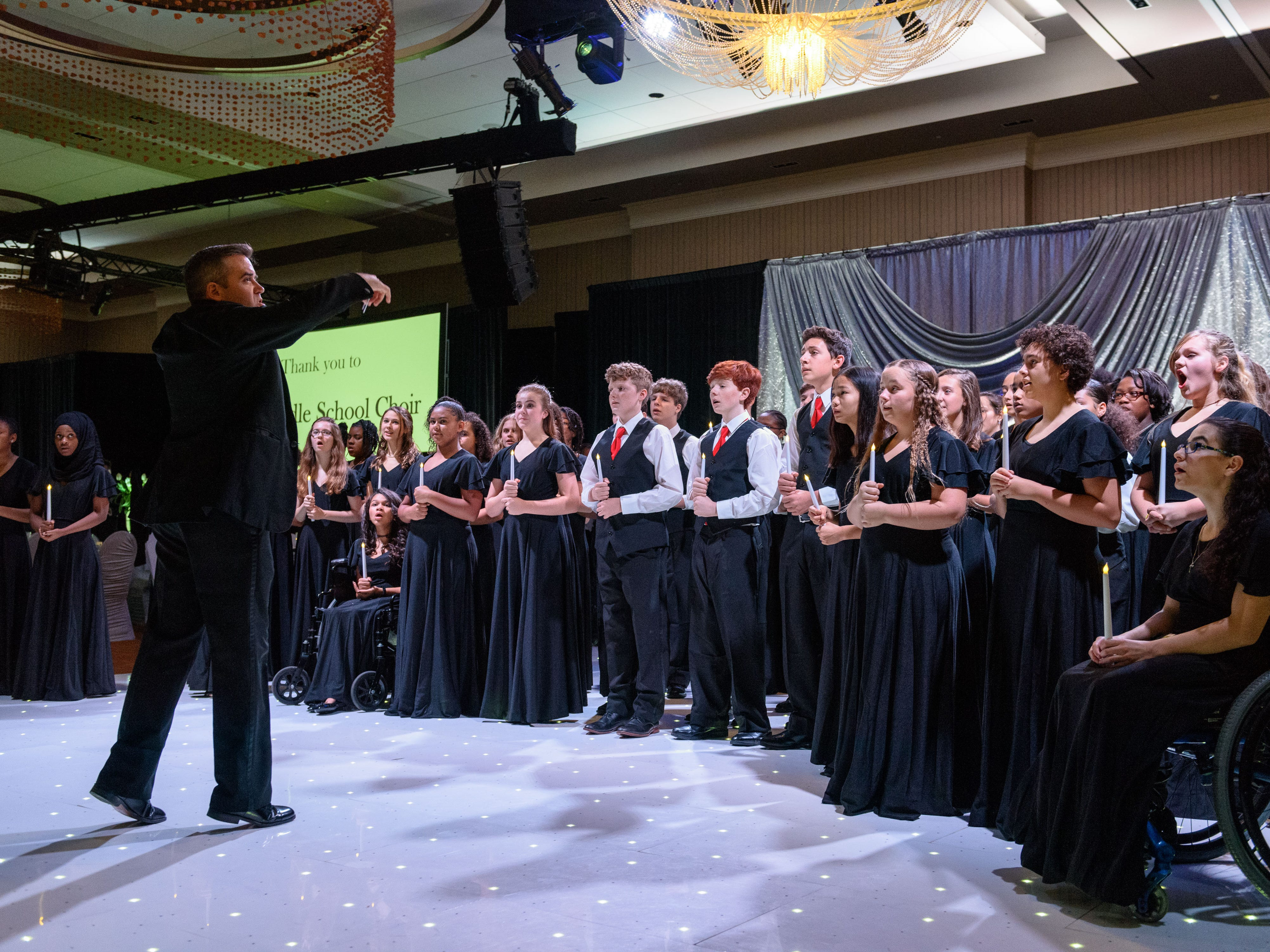 Music by the Noe Middle School Choir perform for guests arriving for dinner at the Snow Ball Gala at the Omni Hotel, a benefit for the Jennifer Lawrence Cardiac Intensive Care Unit (CICU) at Norton ChildrenÕs Hospital. 