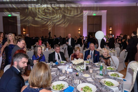 Karen and Gary Lawrence take their seats at the Snow Ball Gala at the Omni Hotel, a benefit for the Jennifer Lawrence Cardiac Intensive Care Unit (CICU) at Norton ChildrenÕs Hospital. 