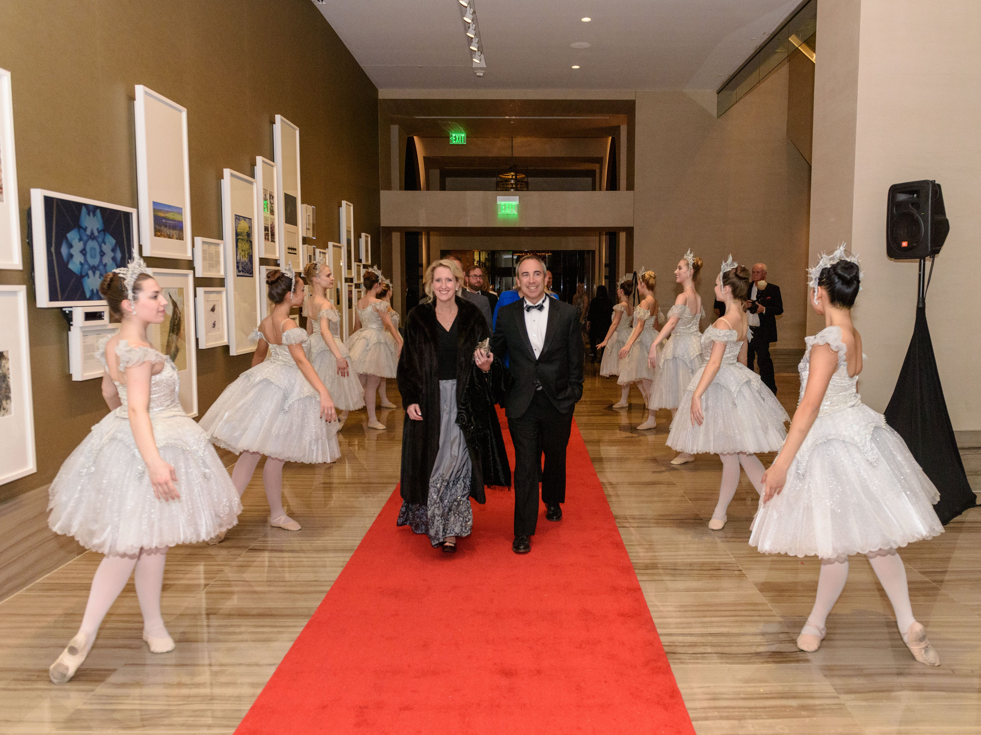 Amy and Lee Garlove walk the red carpets lined with Louisville Ballet dancers at the Snow Ball Gala at the Omni Hotel, a benefit for the Jennifer Lawrence Cardiac Intensive Care Unit (CICU) at Norton ChildrenÕs Hospital. Nov. 17, 2018