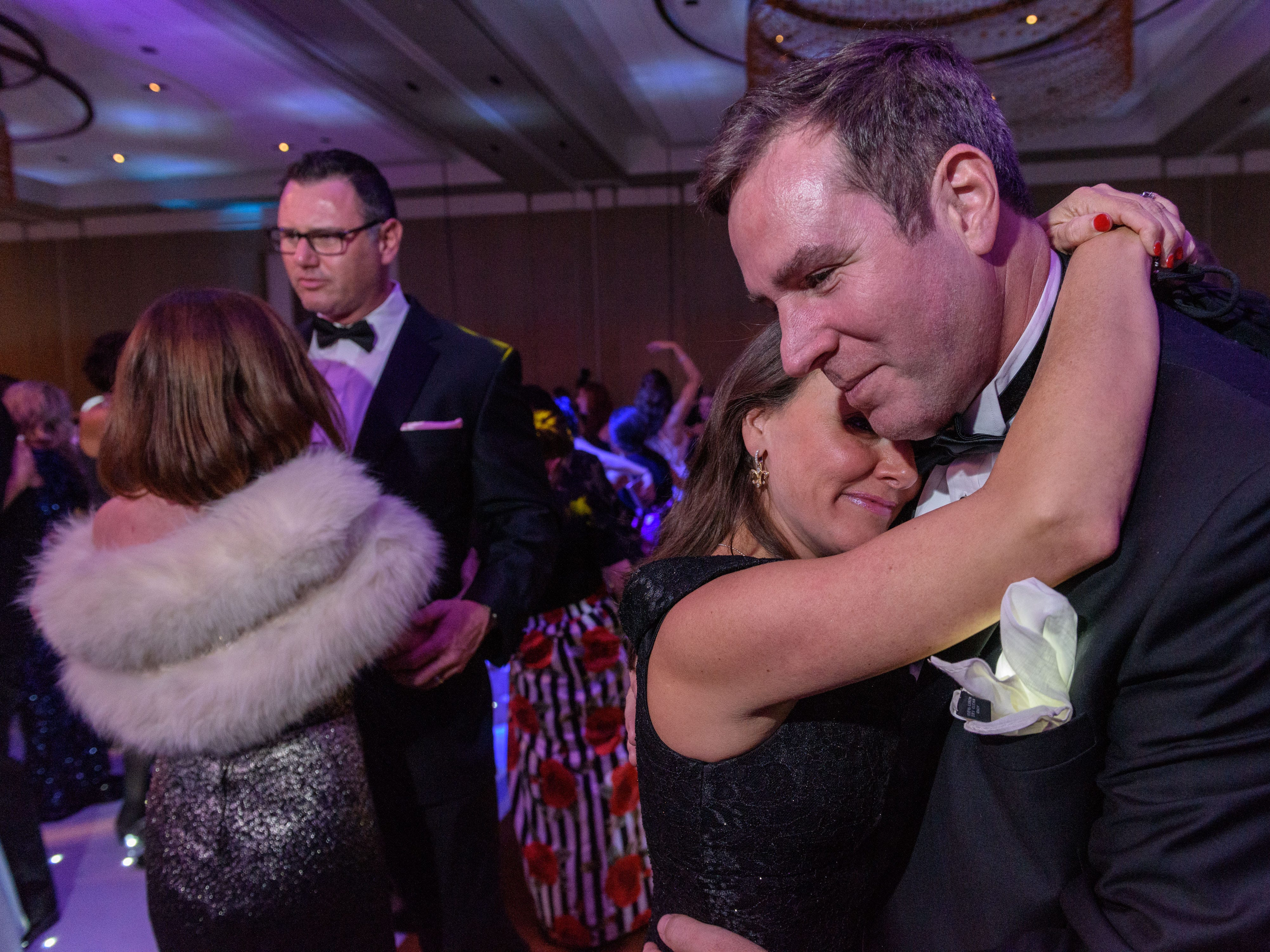 """A couple dances to The Bee Gee's """"How deep is your love"""" at the Snow Ball Gala at the Omni Hotel, a benefit for the Jennifer Lawrence Cardiac Intensive Care Unit (CICU) at Norton ChildrenÕs Hospital. Nov. 17, 2018"""