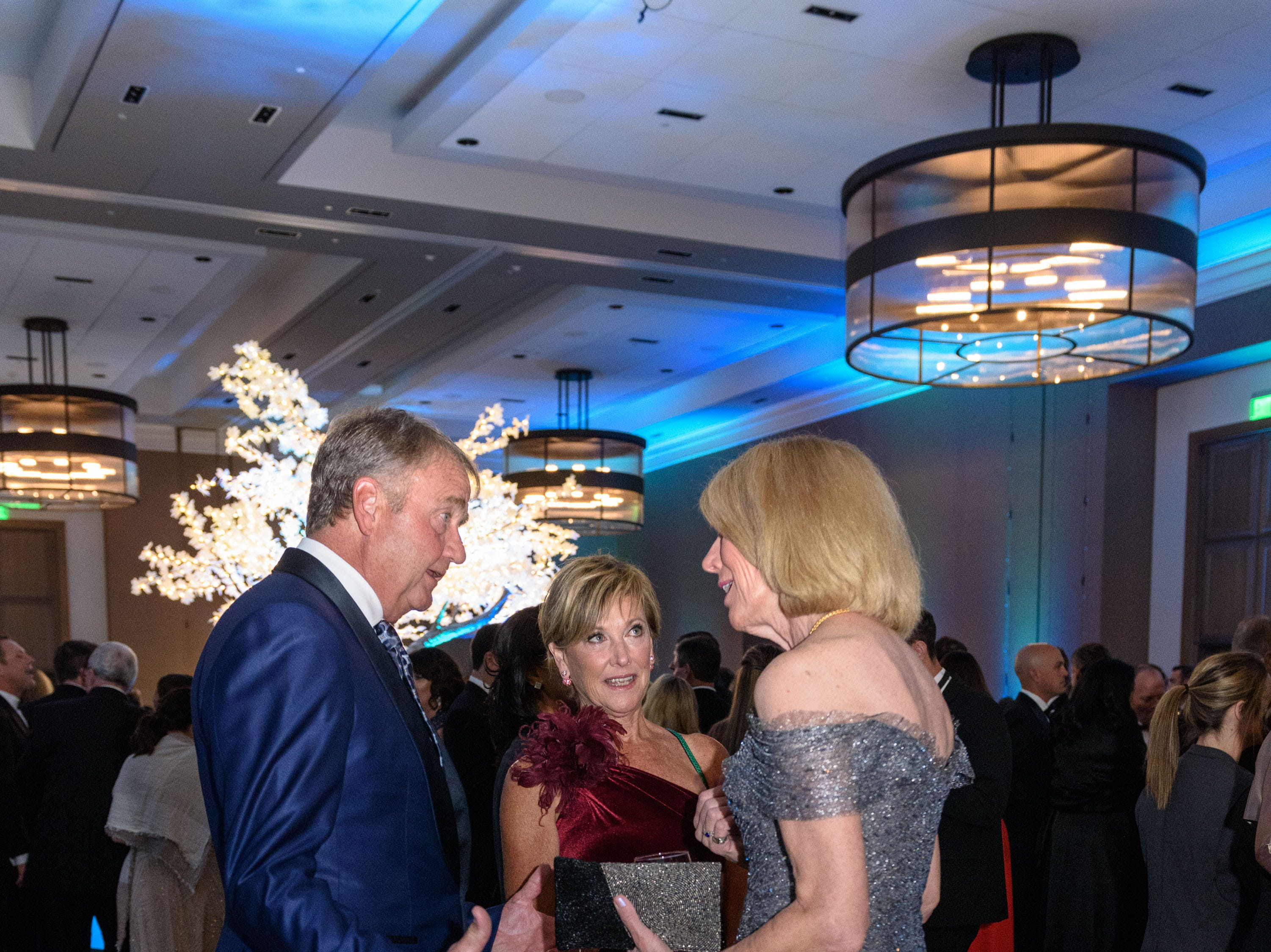 Gary and Karen Lawrence talk with Dr. Martha Heyburn at the Snow Ball Gala at the Omni Hotel, a benefit for the Jennifer Lawrence Cardiac Intensive Care Unit (CICU) at Norton ChildrenÕs Hospital. Nov. 17, 2018