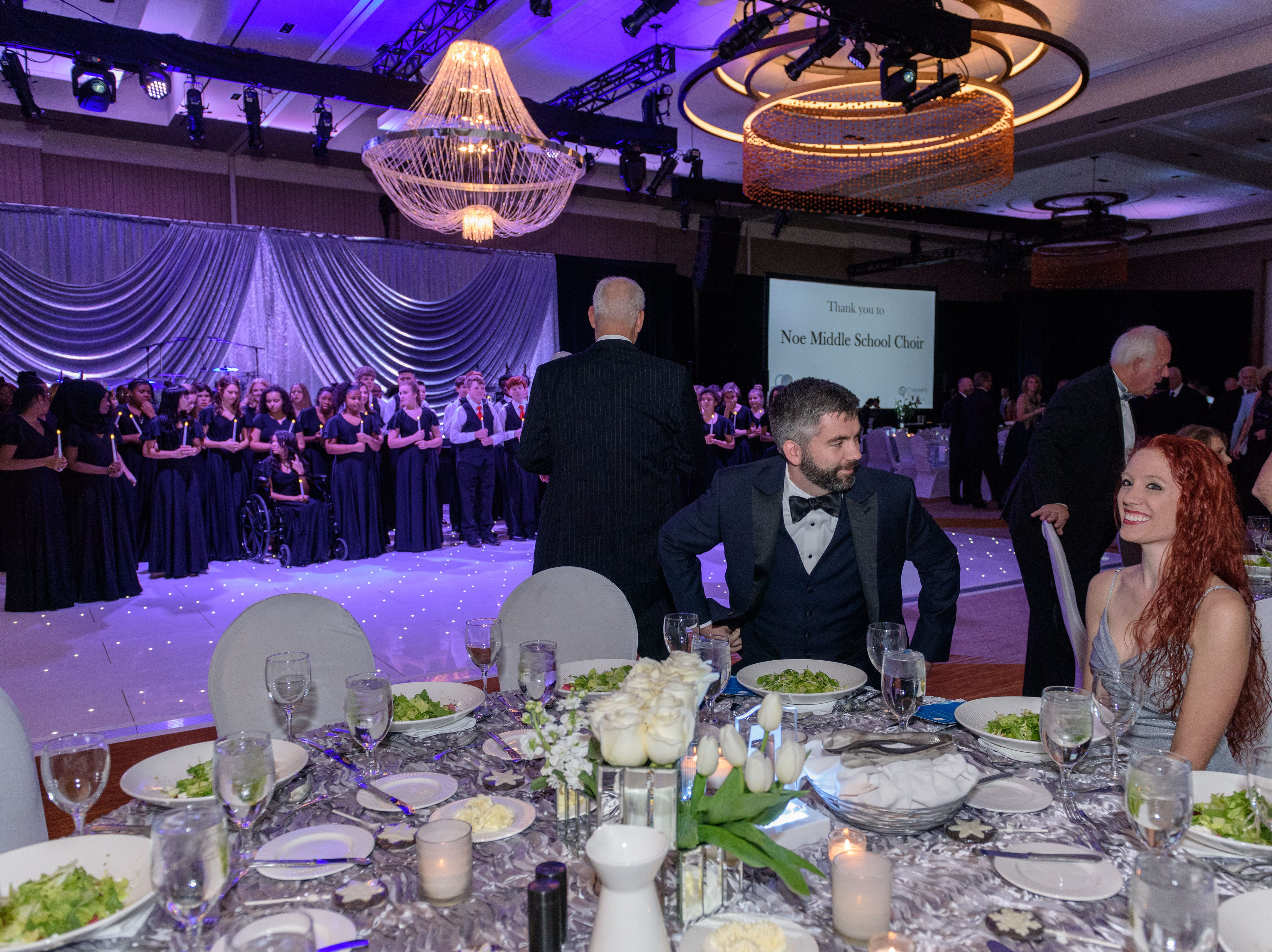 Sam Stewart and Sarah Daley take their seats at the Snow Ball Gala at the Omni Hotel, a benefit for the Jennifer Lawrence Cardiac Intensive Care Unit (CICU) at Norton ChildrenÕs Hospital. Nov. 17, 2018