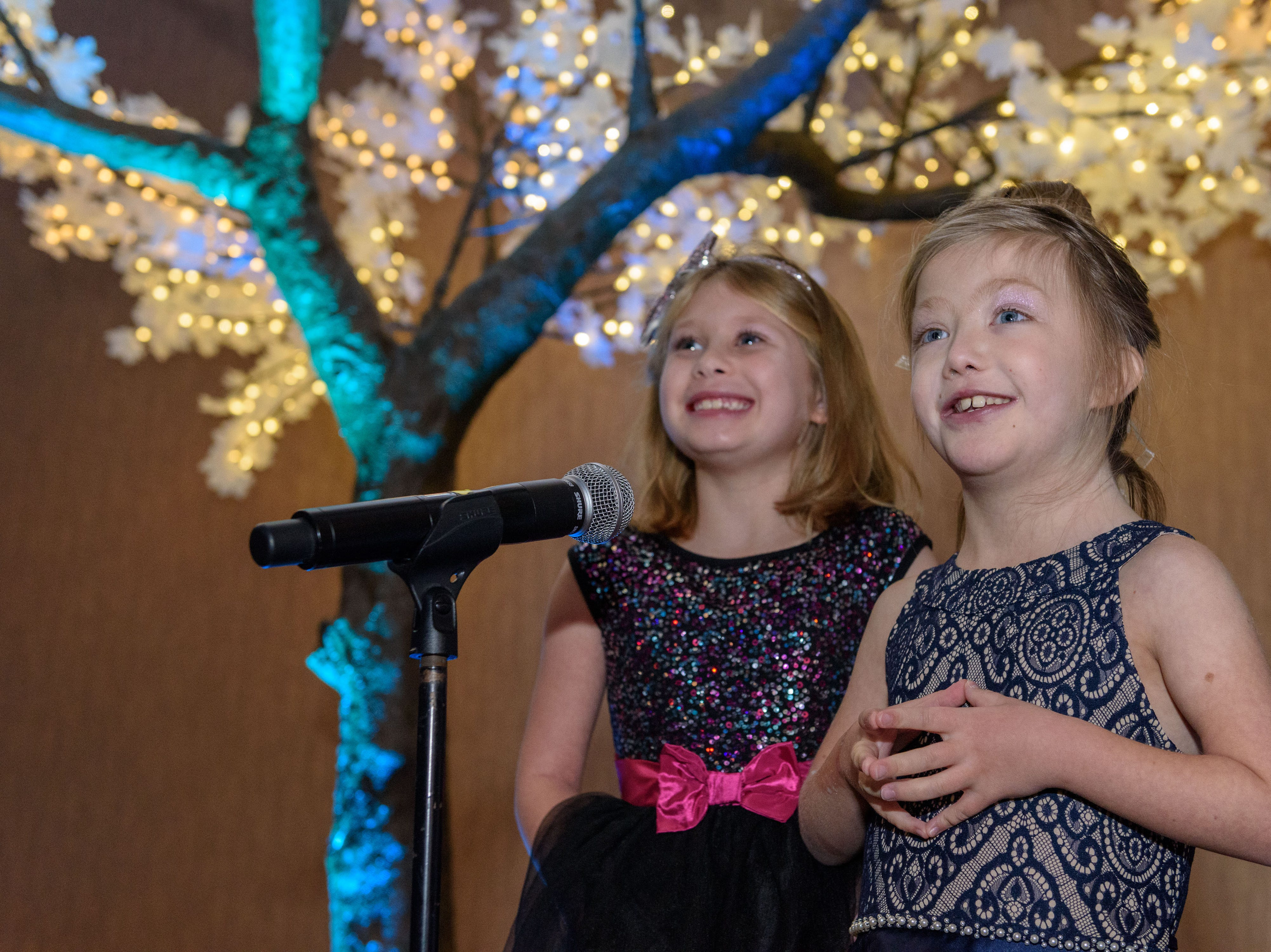 Rosie Bowling and Lilly Brown call guests to dinner at the Snow Ball Gala at the Omni Hotel, a benefit for the Jennifer Lawrence Cardiac Intensive Care Unit (CICU) at Norton ChildrenÕs Hospital. Nov. 17, 2018