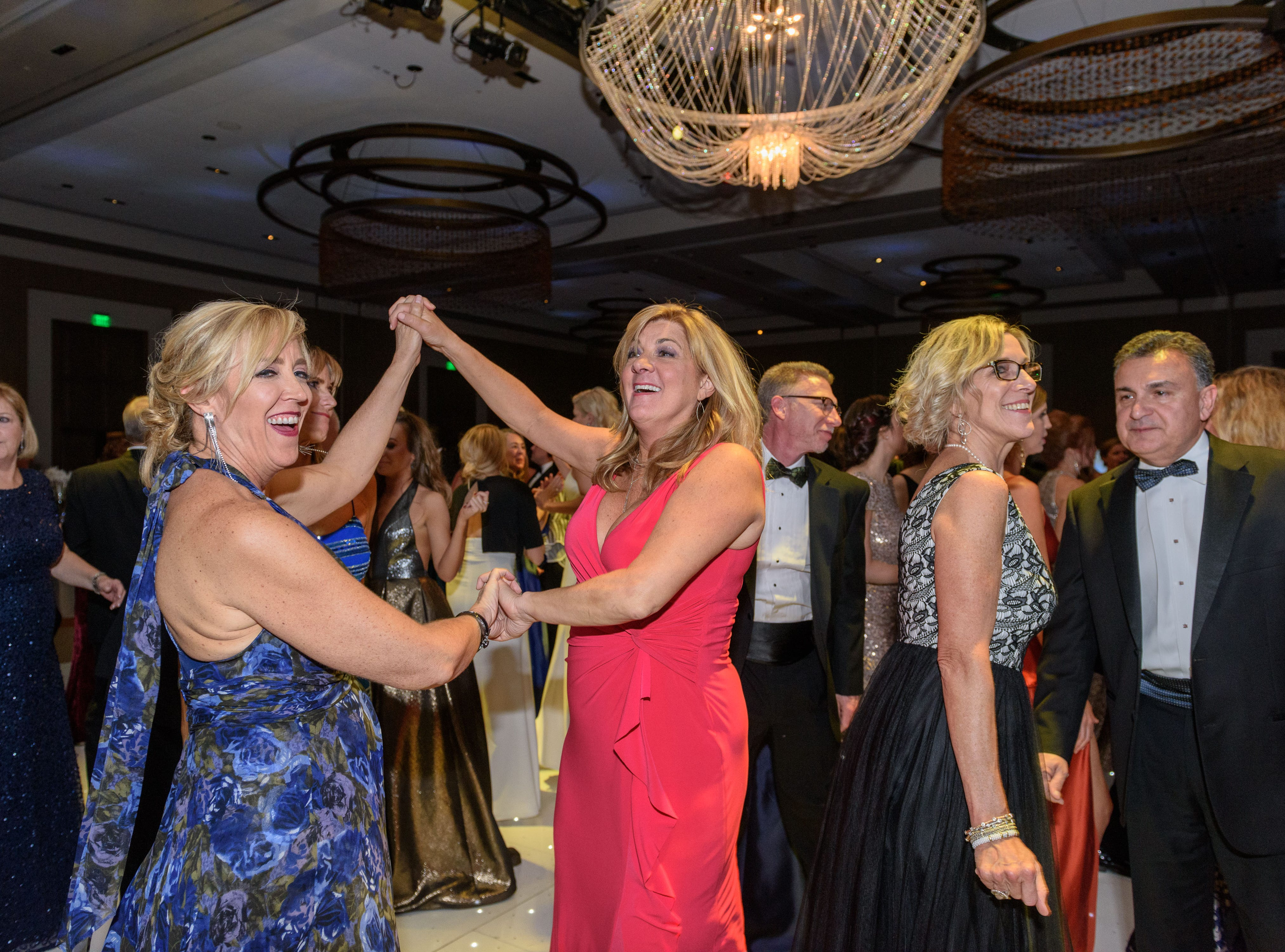 Guests dance to the Endless Summer Band at the Snow Ball Gala at the Omni Hotel, a benefit for the Jennifer Lawrence Cardiac Intensive Care Unit (CICU) at Norton ChildrenÕs Hospital. Nov. 17, 2018