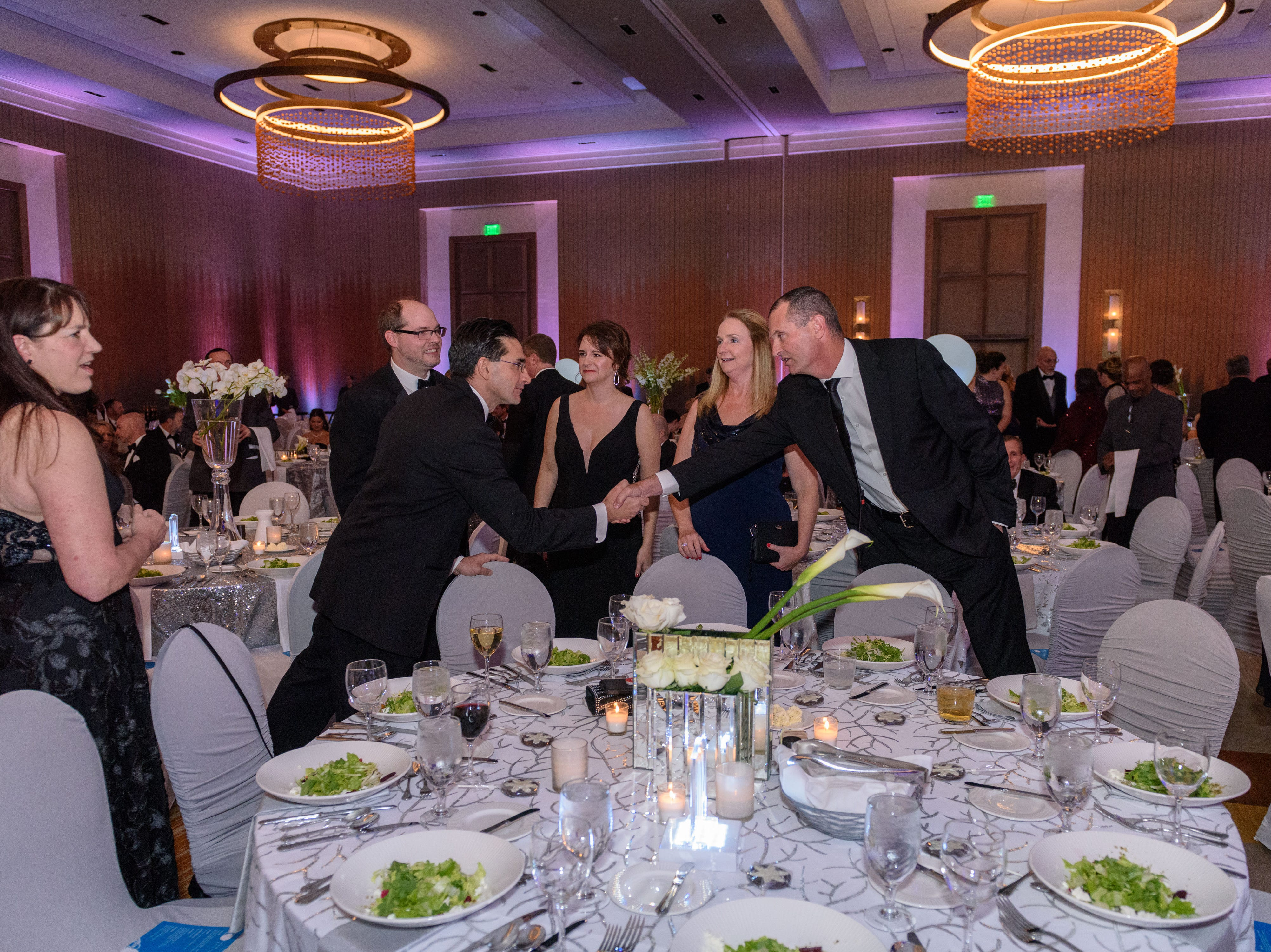 Guests greet each other at the Snow Ball Gala at the Omni Hotel, a benefit for the Jennifer Lawrence Cardiac Intensive Care Unit (CICU) at Norton ChildrenÕs Hospital. 
