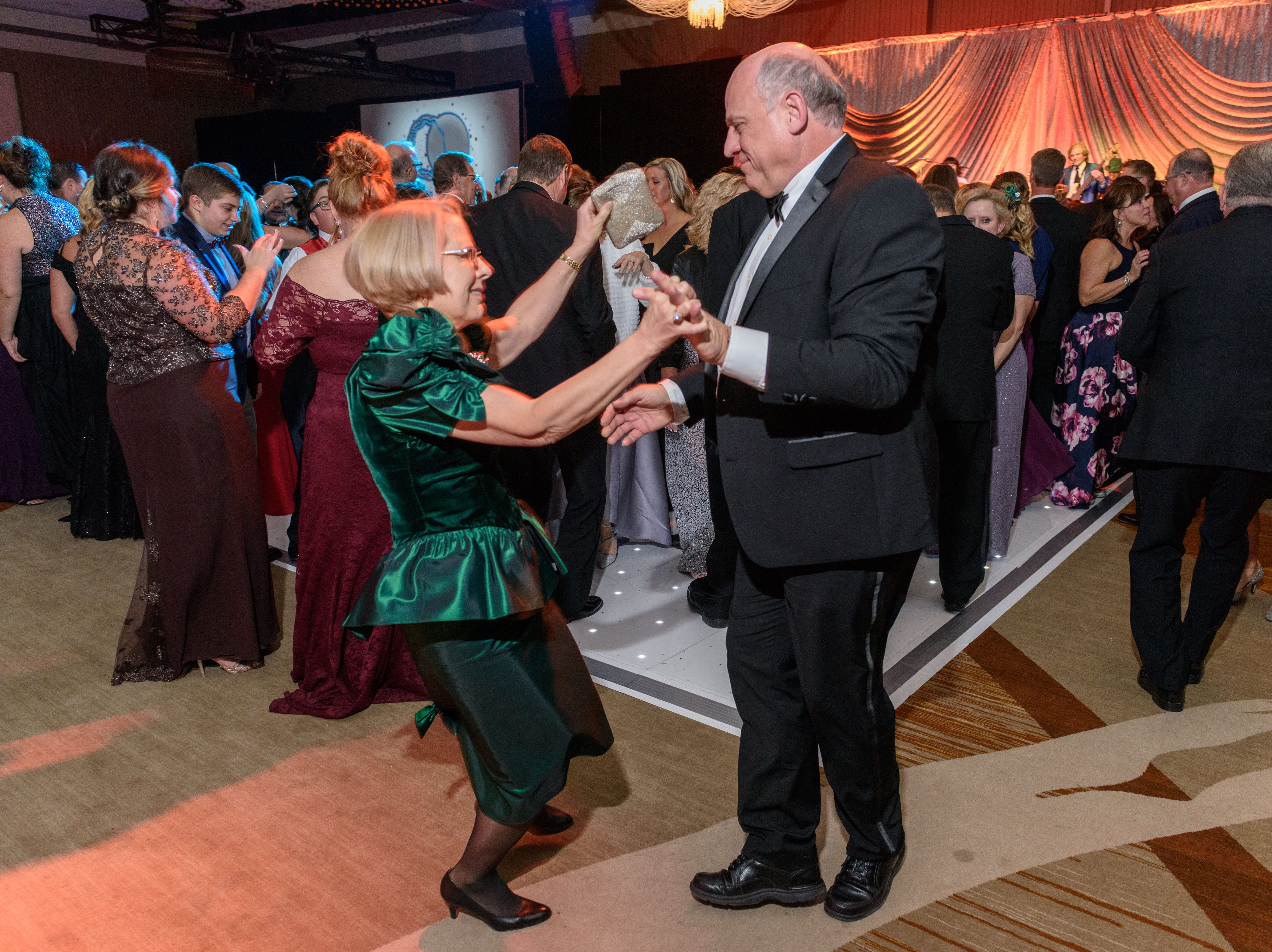 Tom and Jean Vaughn dance to the Endless Summer Band at the Snow Ball Gala at the Omni Hotel, a benefit for the Jennifer Lawrence Cardiac Intensive Care Unit (CICU) at Norton ChildrenÕs Hospital. Nov. 17, 2018