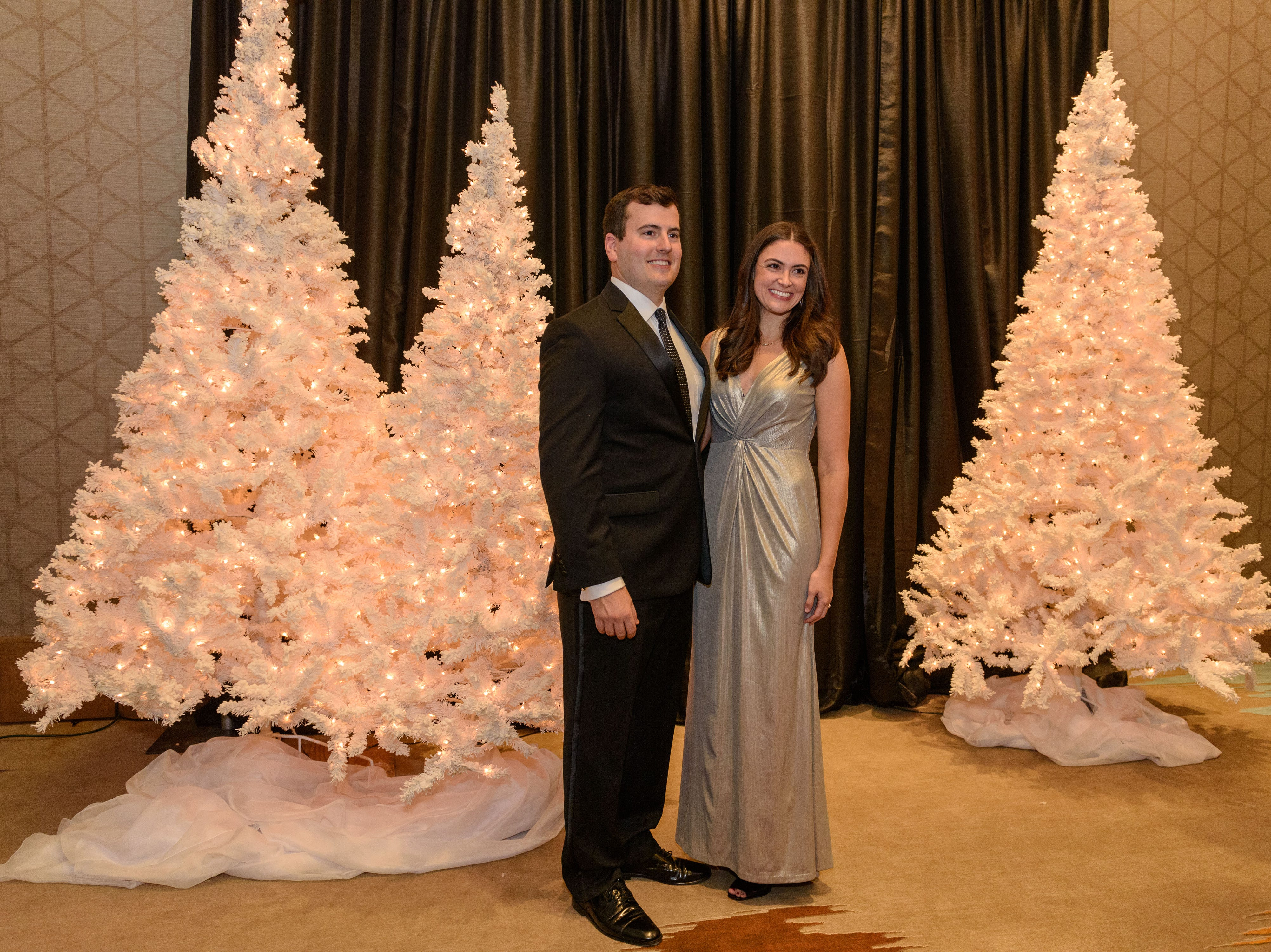 Sarah and Michael Anderson pose for a complimentary photo at the Snow Ball Gala at the Omni Hotel, a benefit for the Jennifer Lawrence Cardiac Intensive Care Unit (CICU) at Norton ChildrenÕs Hospital. Nov. 17, 2018
