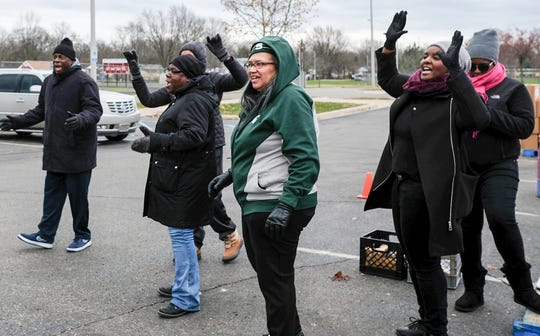 Members of Earvin Magic Johnson's family perform a cheer during the annual Pathway to the Holidays event at Everett High School Sunday, Nov. 18, 2018. The event provided 500 Thanksgiving boxes including a turkey for low income families.