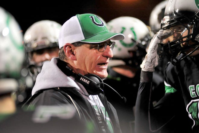 Clear Fork football coach Dave Carroll talks to his players after the team's lost to St. Marys at Bellefontaine this fall.