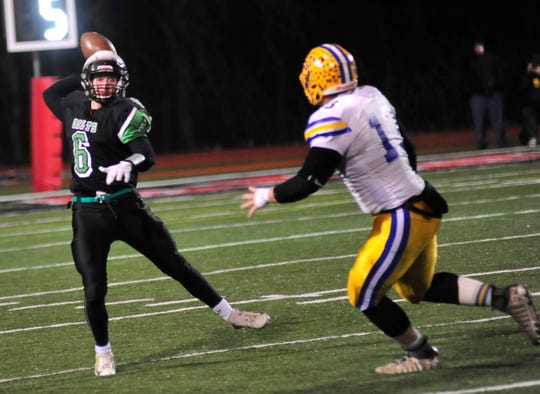 Clear Fork's Jared Schaefer throws a pass while playing against St. Marys at Bellefontaine in the regional championship game.