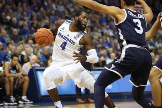 Memphis Tigers forward Raynere Thornton makes a step back move as Yale Bulldogs' Alex Copeland defends during their game at the FedExForum on Saturday, November 17, 2018.