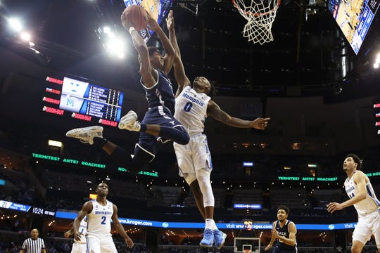 Memphis Tigers forward Kyvon Davenport blocks a shot by Yale's Trey Phills during the Tiger's 109-102 double overtime win at the FedExForum on Saturday, Nov. 17, 2018.