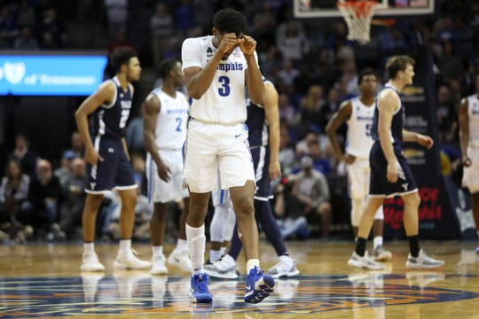 Memphis guard Jeremiah Martin walks back to the bench after missing a free throw Saturday.