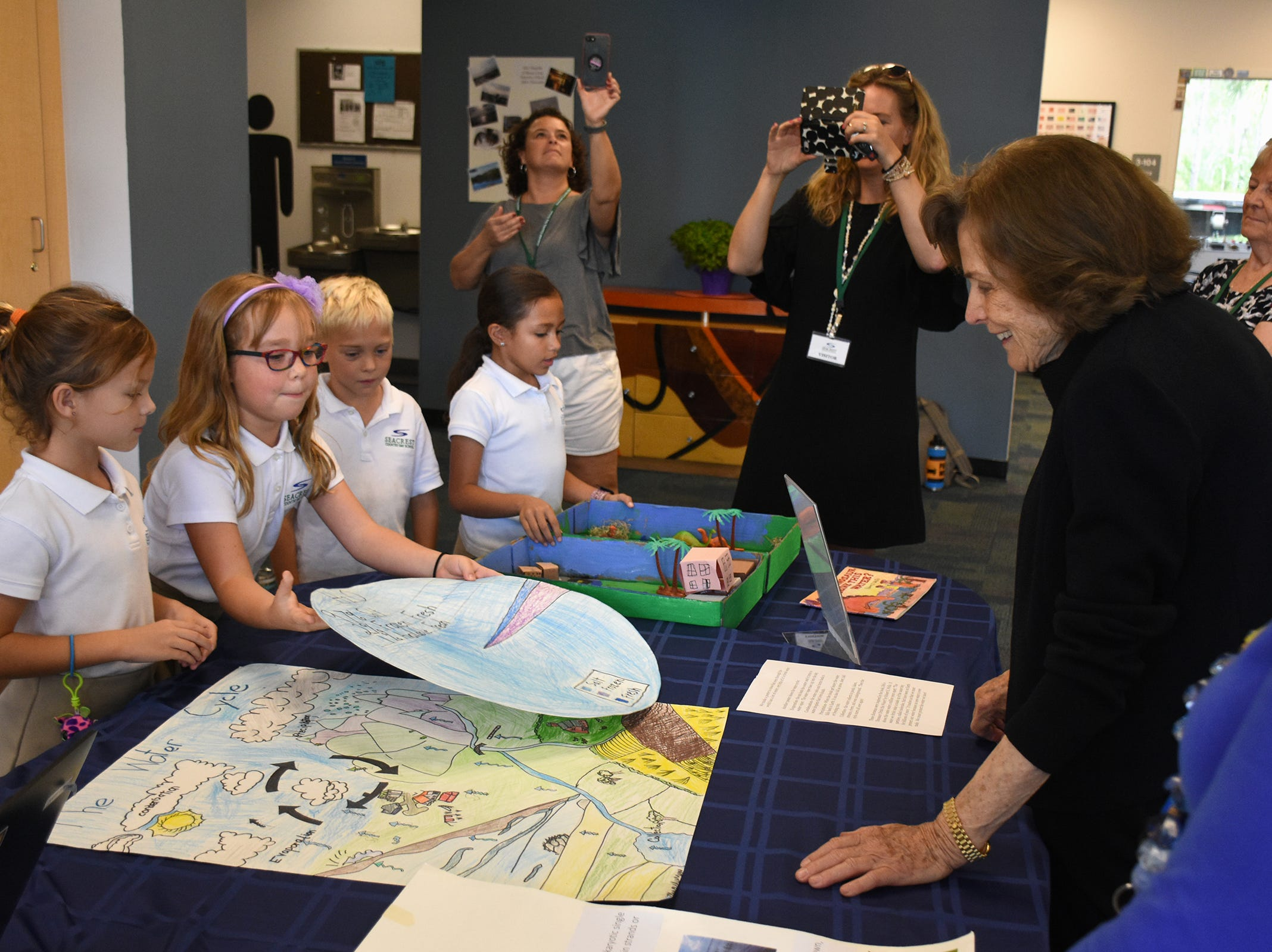 Second grade students share their ocean project with the marine scientist. Seacrest Country Day School students heard from a renowned oceanographer, and she heard from them, when Dr. Sylvia Earle visited the Naples preparatory school for a presentation and workshops on Wednesday, Nov. 14.