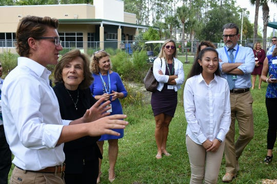 Senior Reilly Peel explains his water filtration project to Dr. Earle. Seacrest Country Day School students heard from a renowned oceanographer, and she heard from them, when Dr. Sylvia Earle visited the Naples preparatory school for a presentation and workshops on Wednesday, Nov. 14.