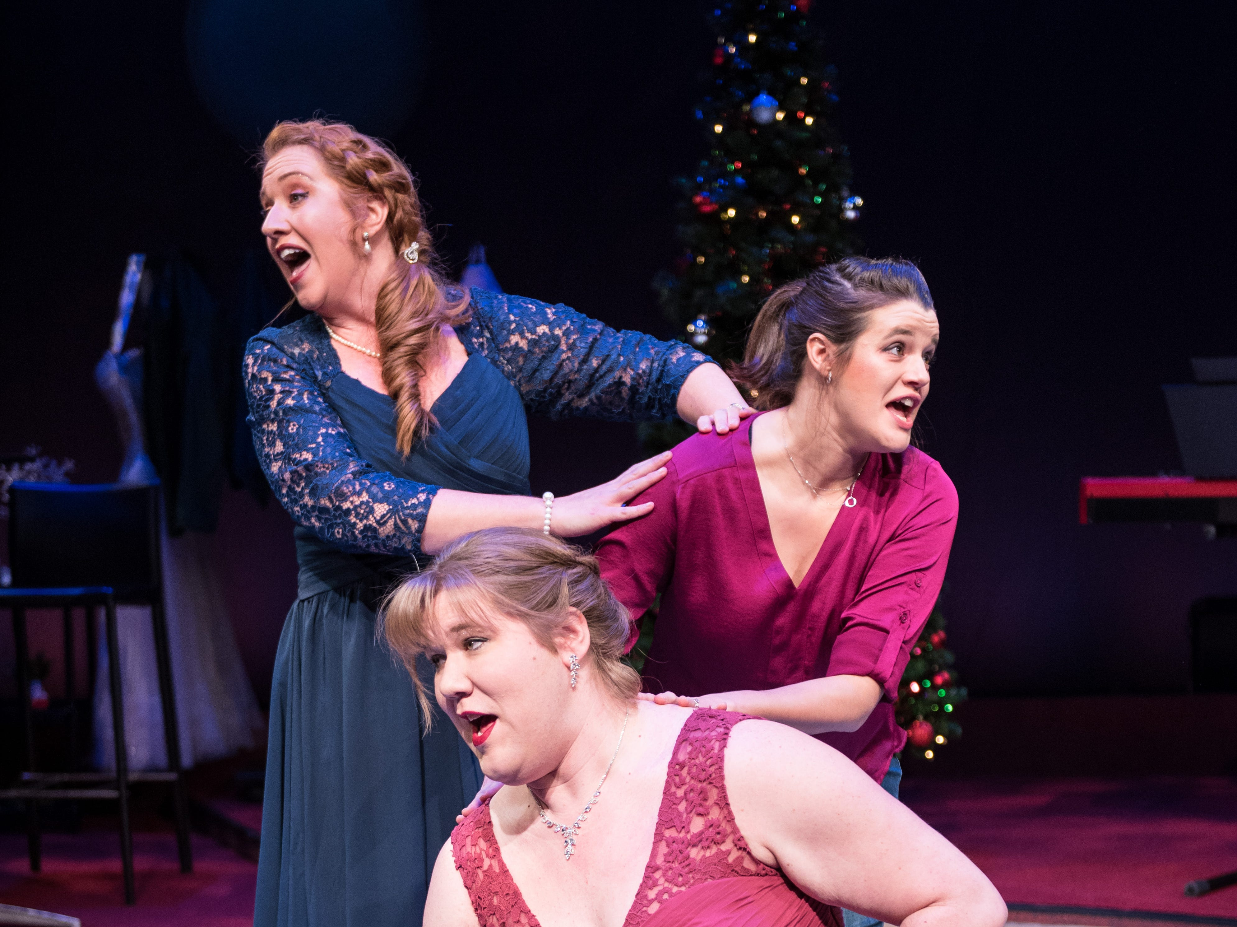 "Marcee Doherty-Elst (back), Susie Duecker and Kelly Doherty sing in ""The Twelve Dates of Christmas"" at Next Act Theatre."