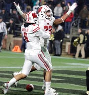 Badgers running back Jonathan Taylor celebrates his game-winning touchdown with Wisconsin Badgers wide receiver Danny Davis III.