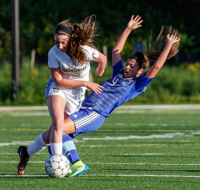 Catholic Memorial freshman Shannon McWilliams (left) tangles with Waukesha West's Dani Rhodes during the match at Carroll College on Tuesday, May 17, 2016.