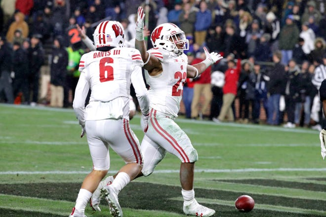 Jonathan Taylor and Danny Davis were two of the Badgers' stars Saturday in the three-OT victory over Purdue.